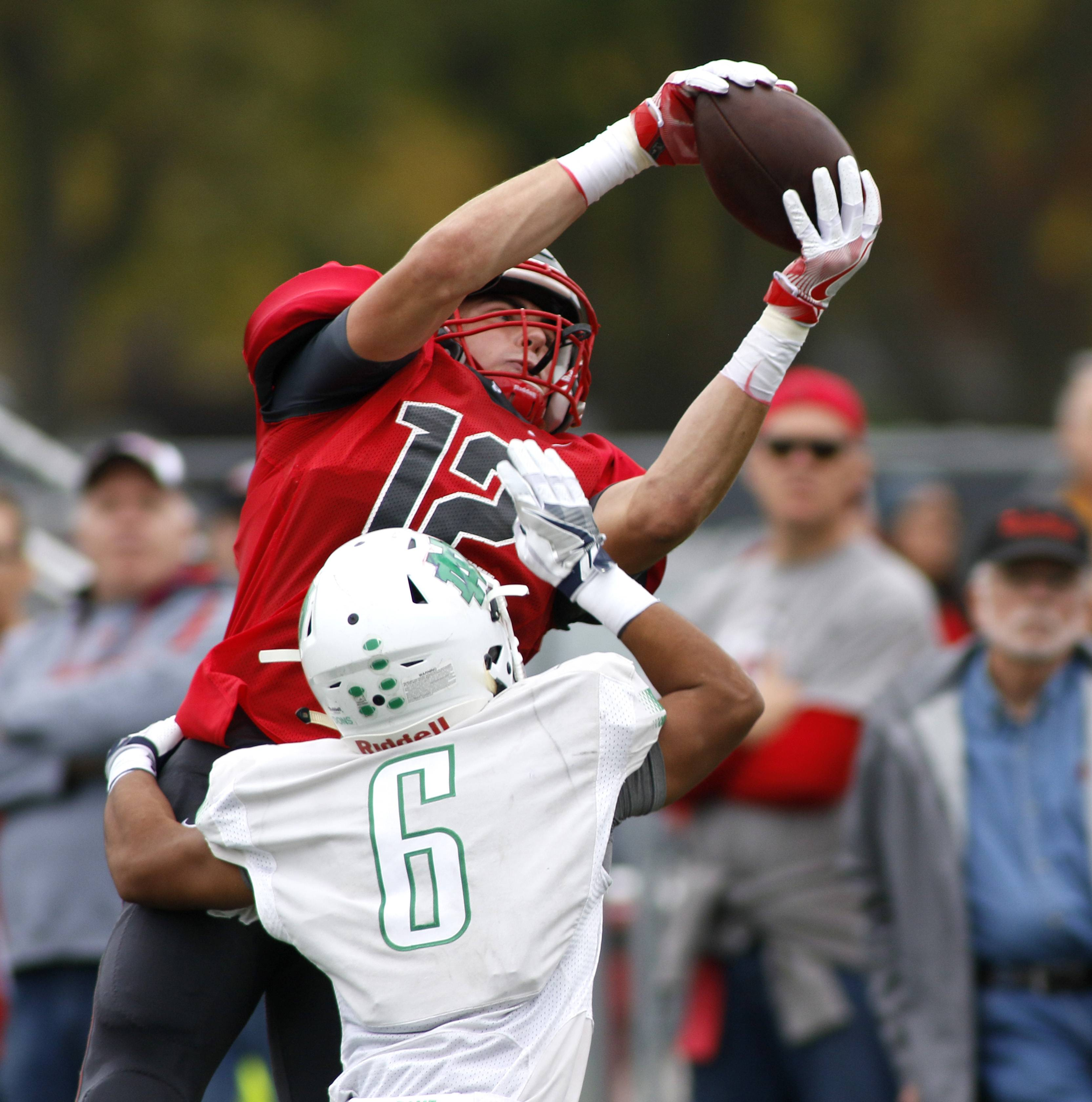 Palatine's Jack Grochowski (12) catches a pass in the end zone which was ruled incomplete against Notre Dame's Michael Valdez (6) during the first round of the Class 8A football playoffs in Palatine.