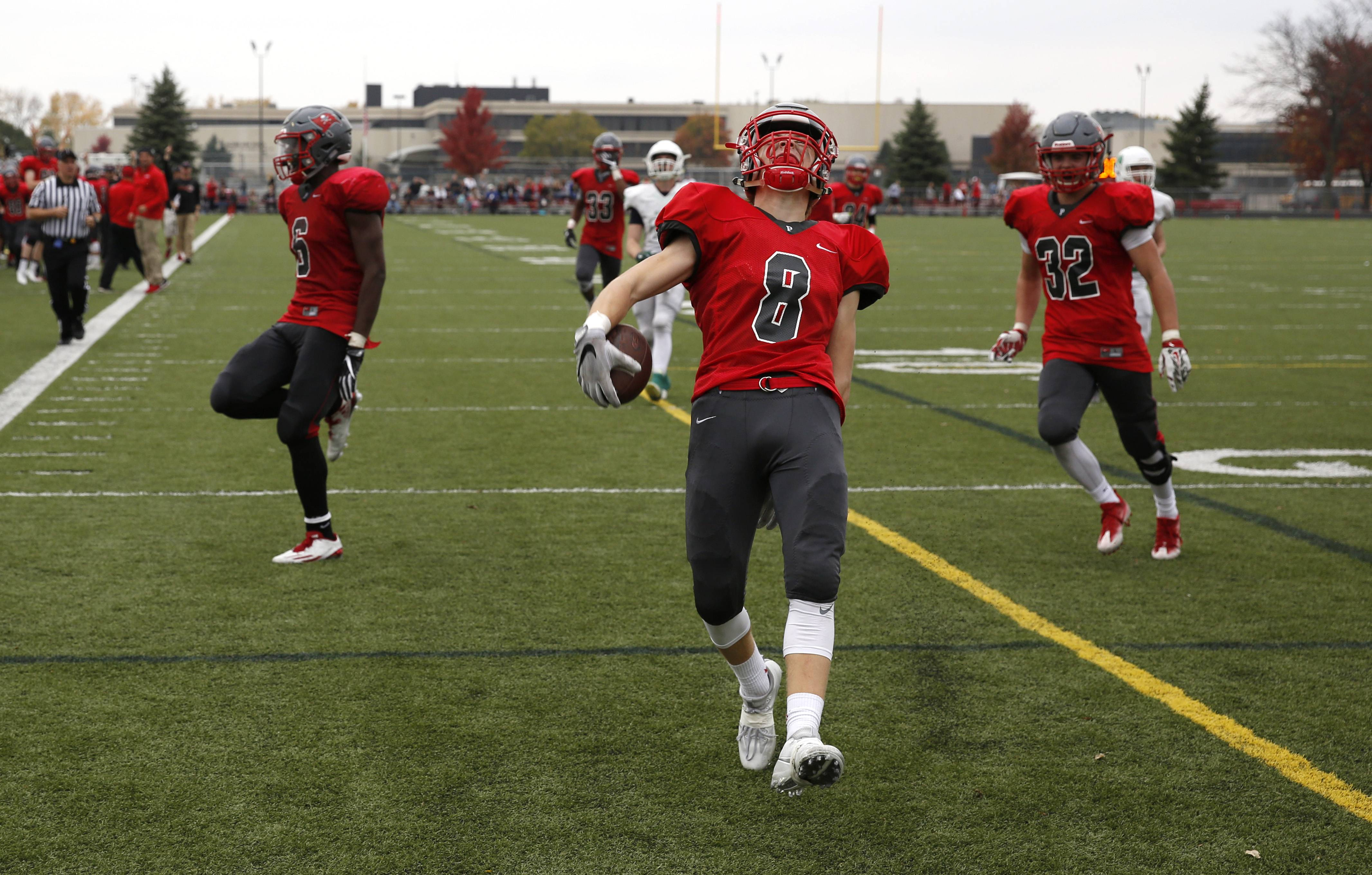 Palatine's Jake Moerti (8) celebrates his fourth quarter interception return for touchdown against Notre Dame during the first round of the Class 8A football playoffs in Palatine.
