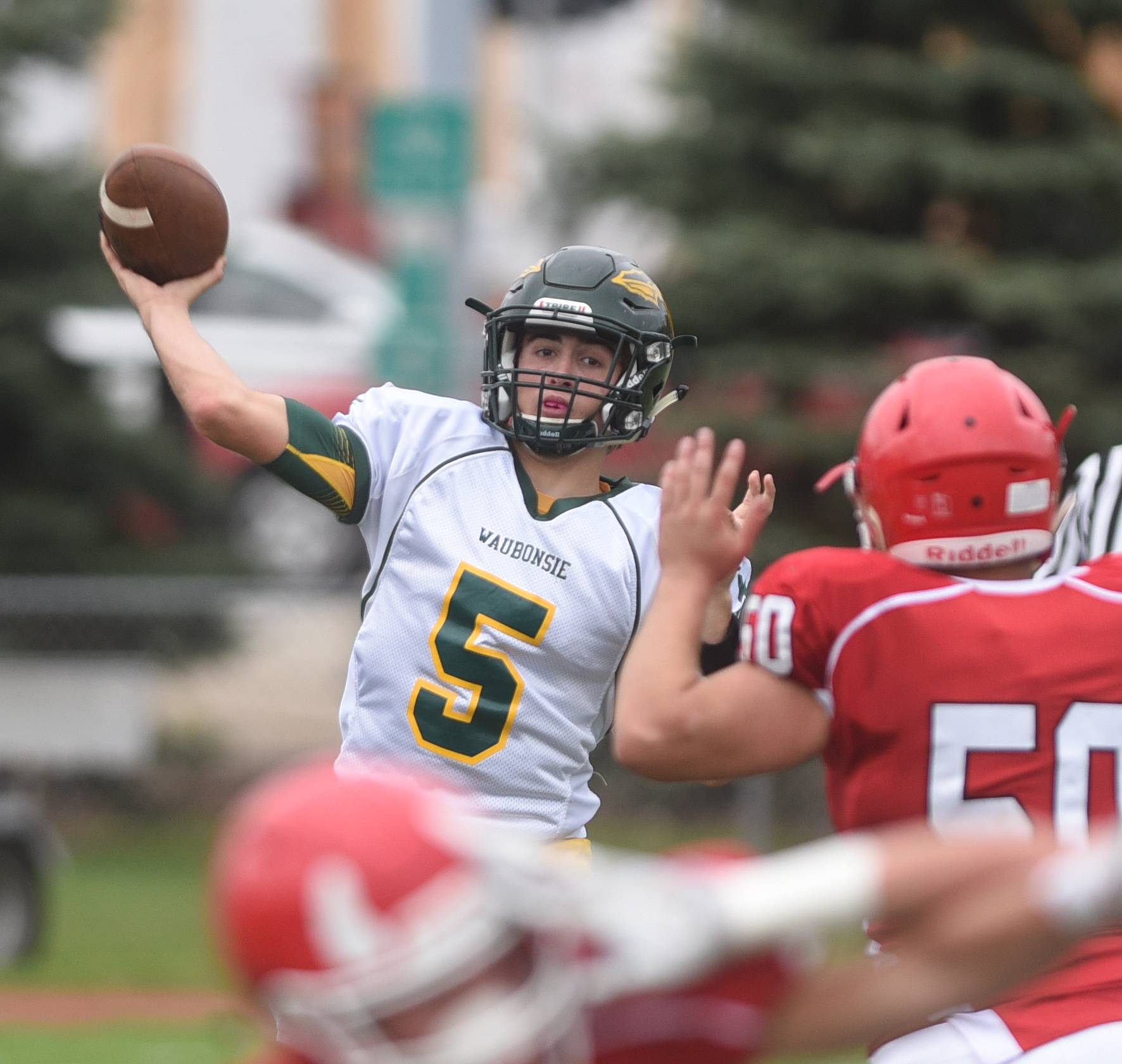 Waubonsie Valley's Tanner Westwood (5) throws a pass during the Waubonsie Valley at Hinsdale Central football game Saturday.