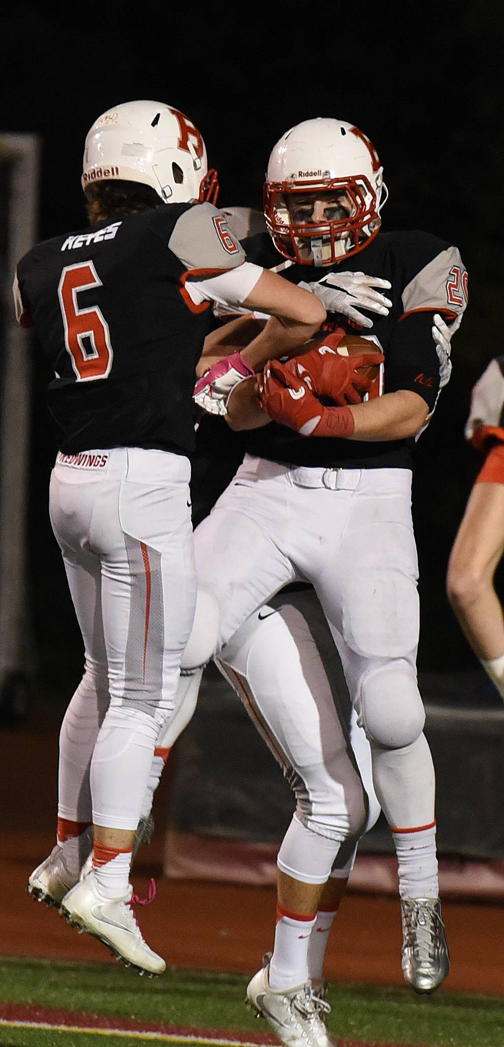 Benet's Nicholas Keyes (6) and Benet's Marty Dosen (20) celebrate a TD during the Hoffman Estates at Benet football game Friday.