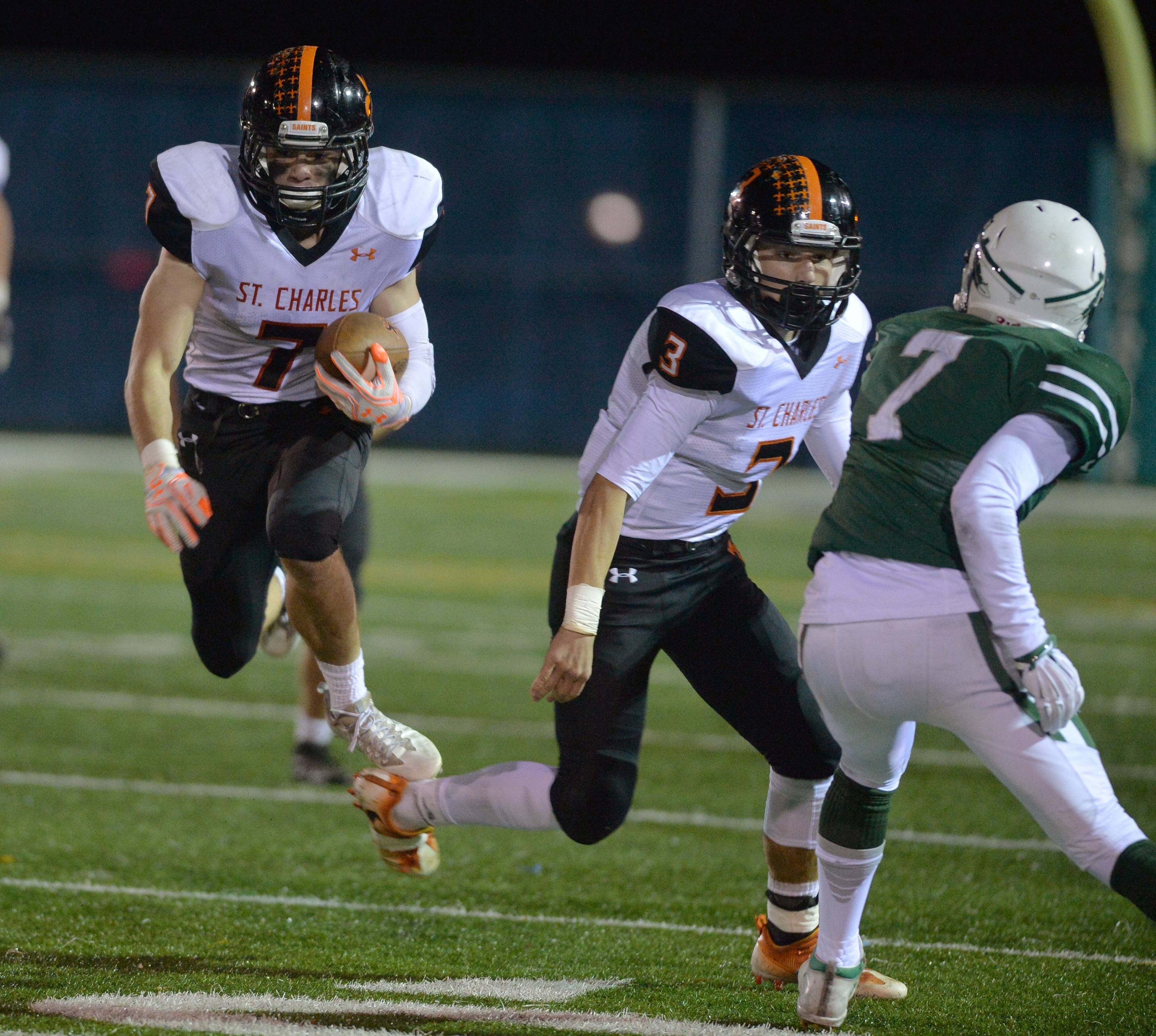 St. Charles East running back Nick Garlisch hurdles a blocker on a run in the third quarter against New Trier Friday in Northfield.