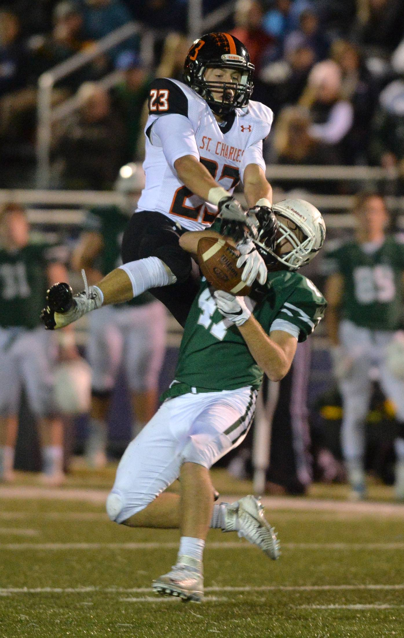 New Trier linebacker Max Bryla intercepts a pass intended for St. Charles East back Sebastian Grohe in the third quarter of their IHSA Class 8A playoff game Friday in Northfield.