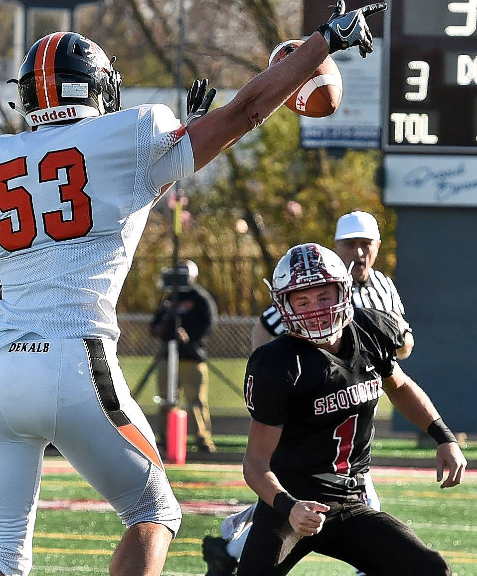 Antioch quarterback Branden Gallimore gets a pass batted down by DeKalb's Samuel Illyes during first-half action in the Class 6A playoffs Saturday.