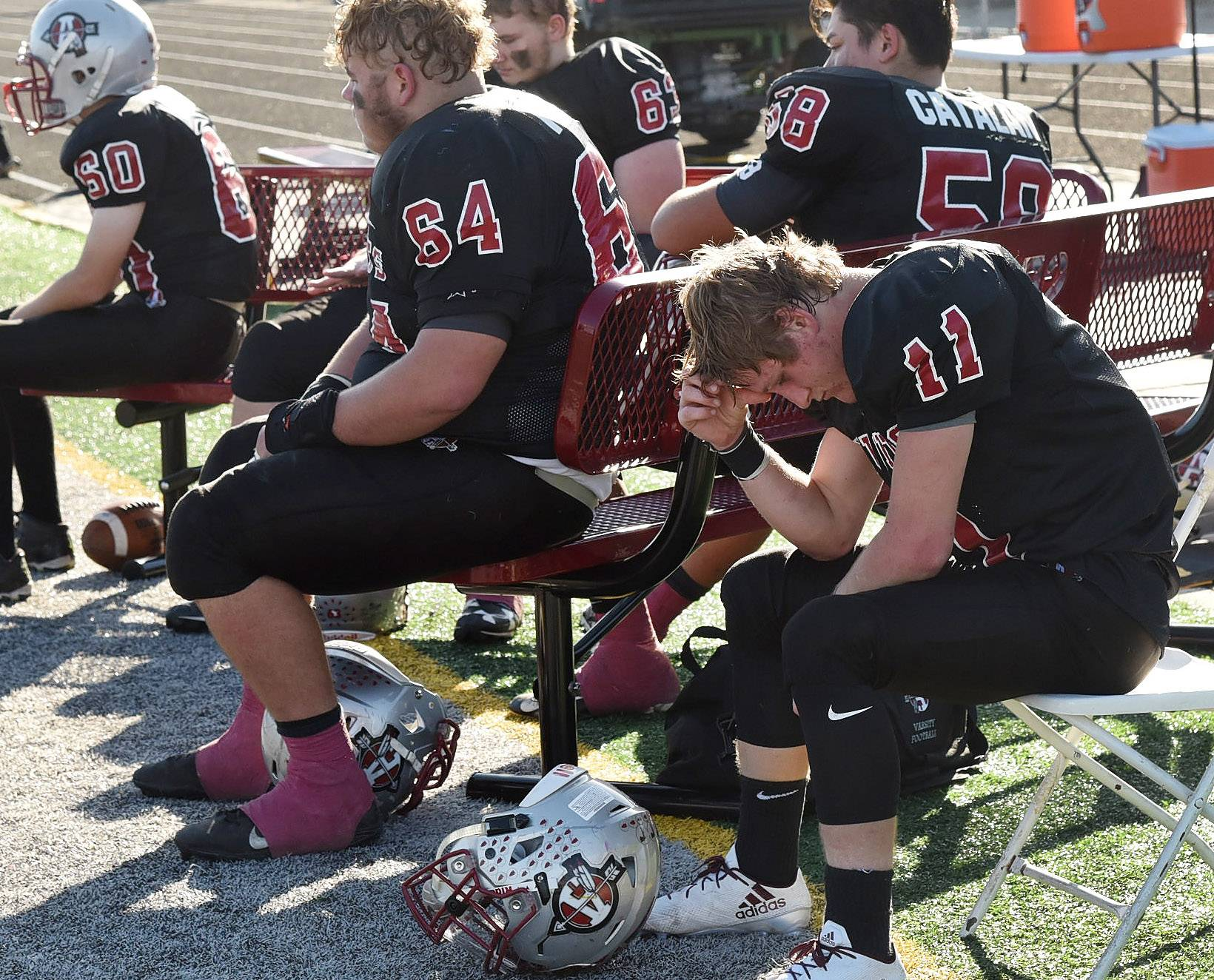 Antioch running back Hunter Price sits dejectedly on the bench after three quarters of play during the Class 6A second-round playoff game between the Sequoits and DeKalb.