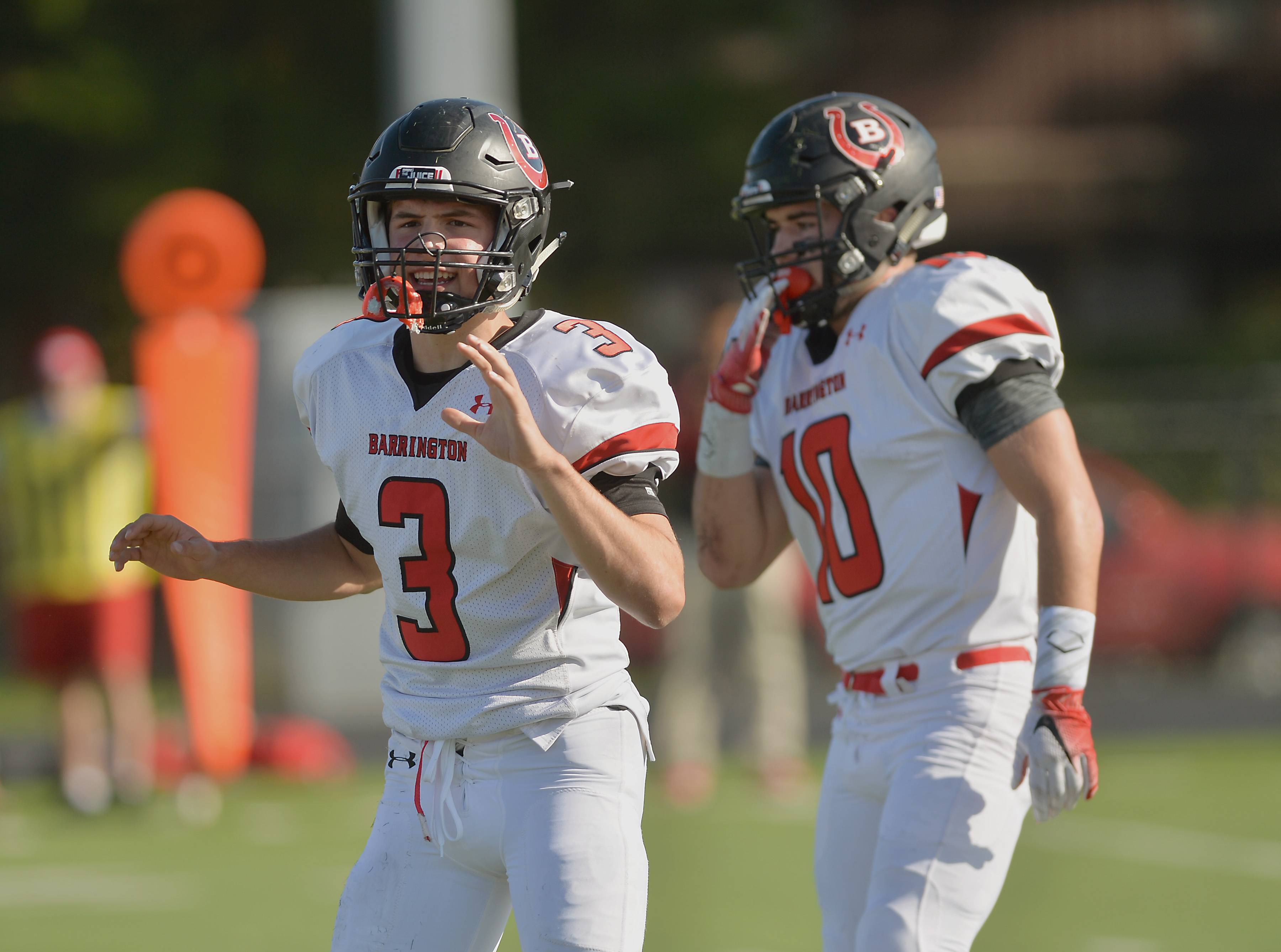 Barrington quarterback Ray Niro makes an adjustment to a play call in the first quarter against host Maine South on Saturday.