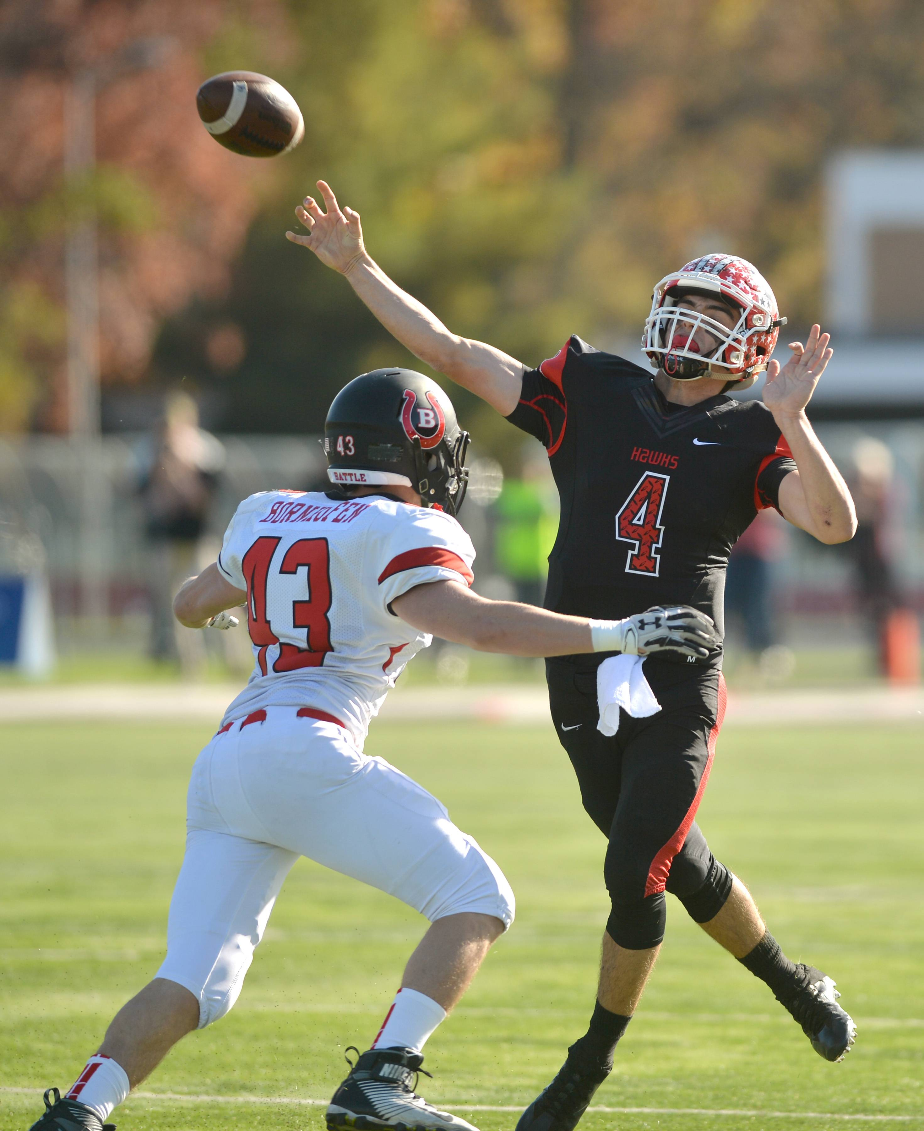 Maine South quarterback Nick Leongas passes under pressure from Barrington linebacker Ryan Bornhofen in Class 8A second-round play Saturday in Park Ridge.