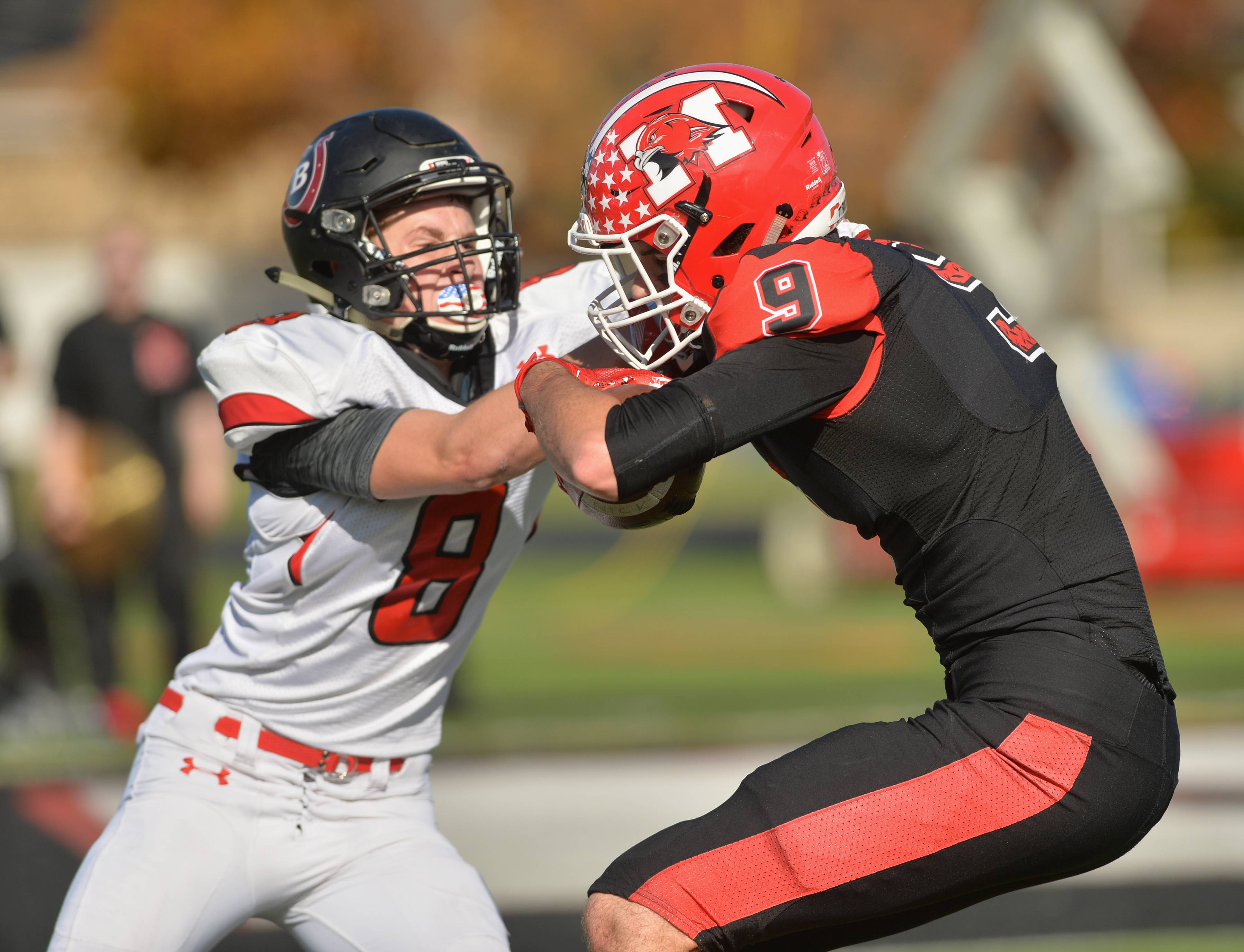 Barrington defensive back Grant Leichter tackles Maine South's Luke Hinkamp after a reception in their second-round playoff game Saturday in Park Ridge.