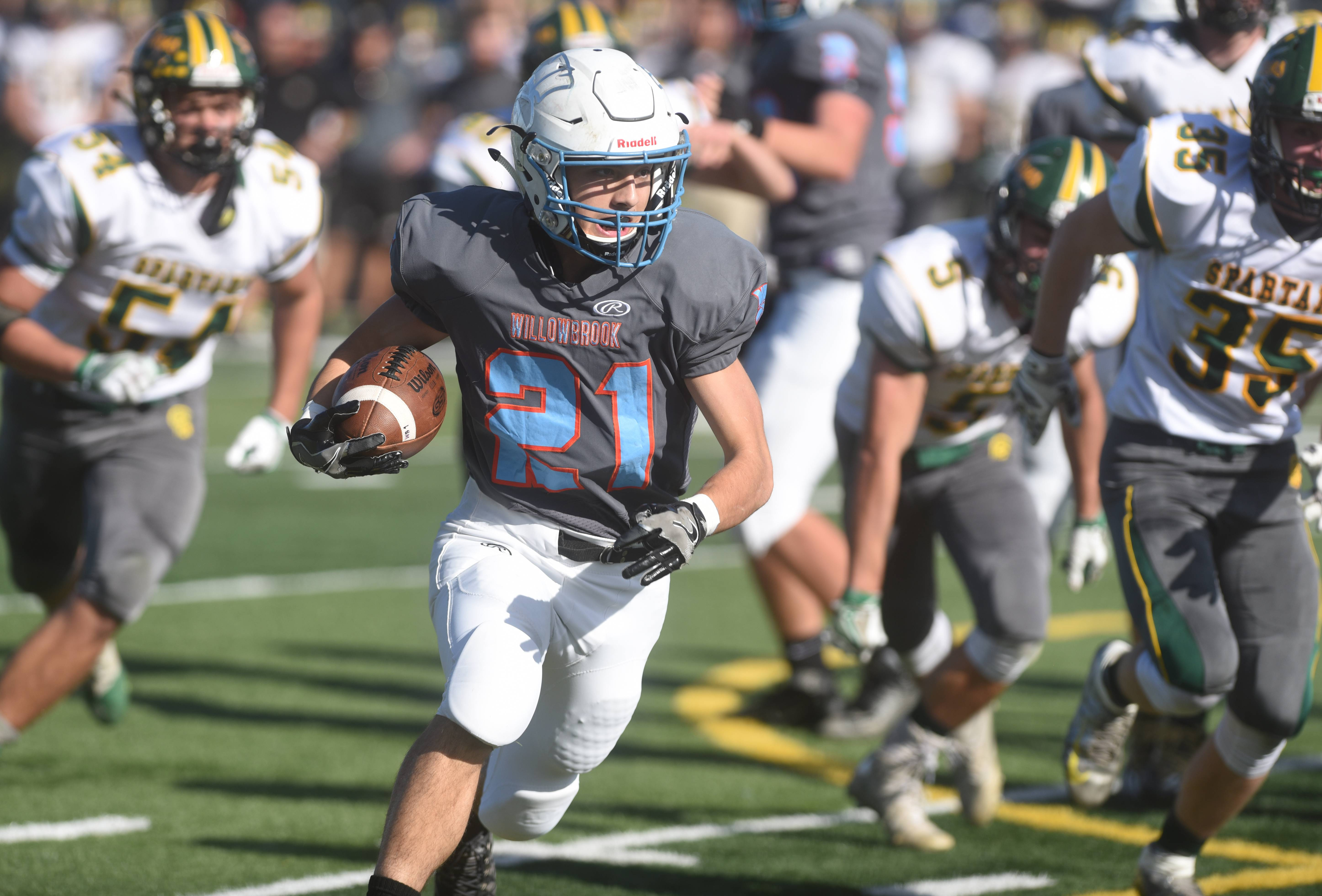 Willowbrook's Chris Diaz (21) runs the ball during the Glenbrook North at Willowbrook football, second-round playoff game Saturday.