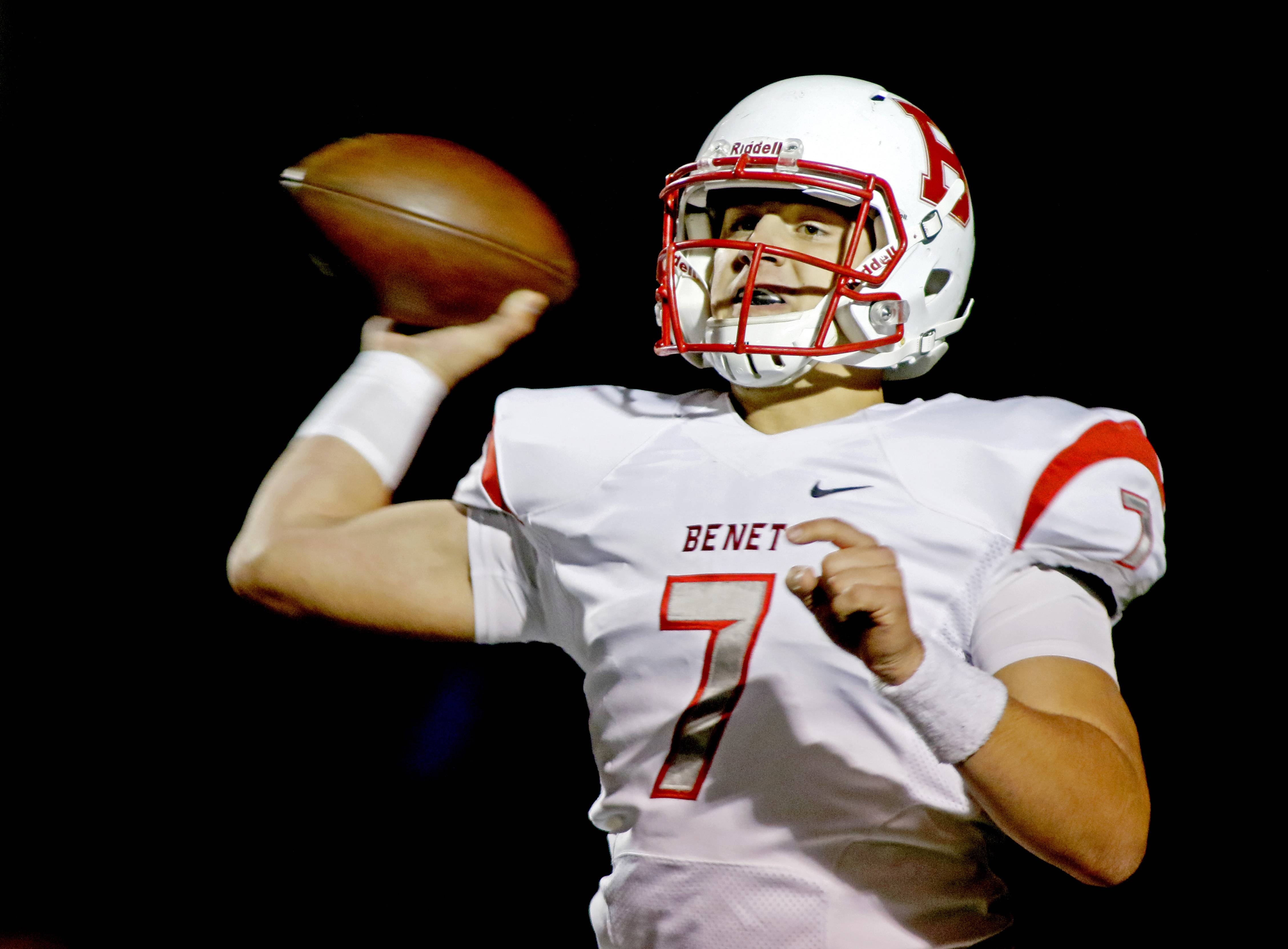 Benet Academy quarterback Jack Sznajder throws a pass over the middle against Rolling Meadows during Class 7A football action in Rolling Meadows.