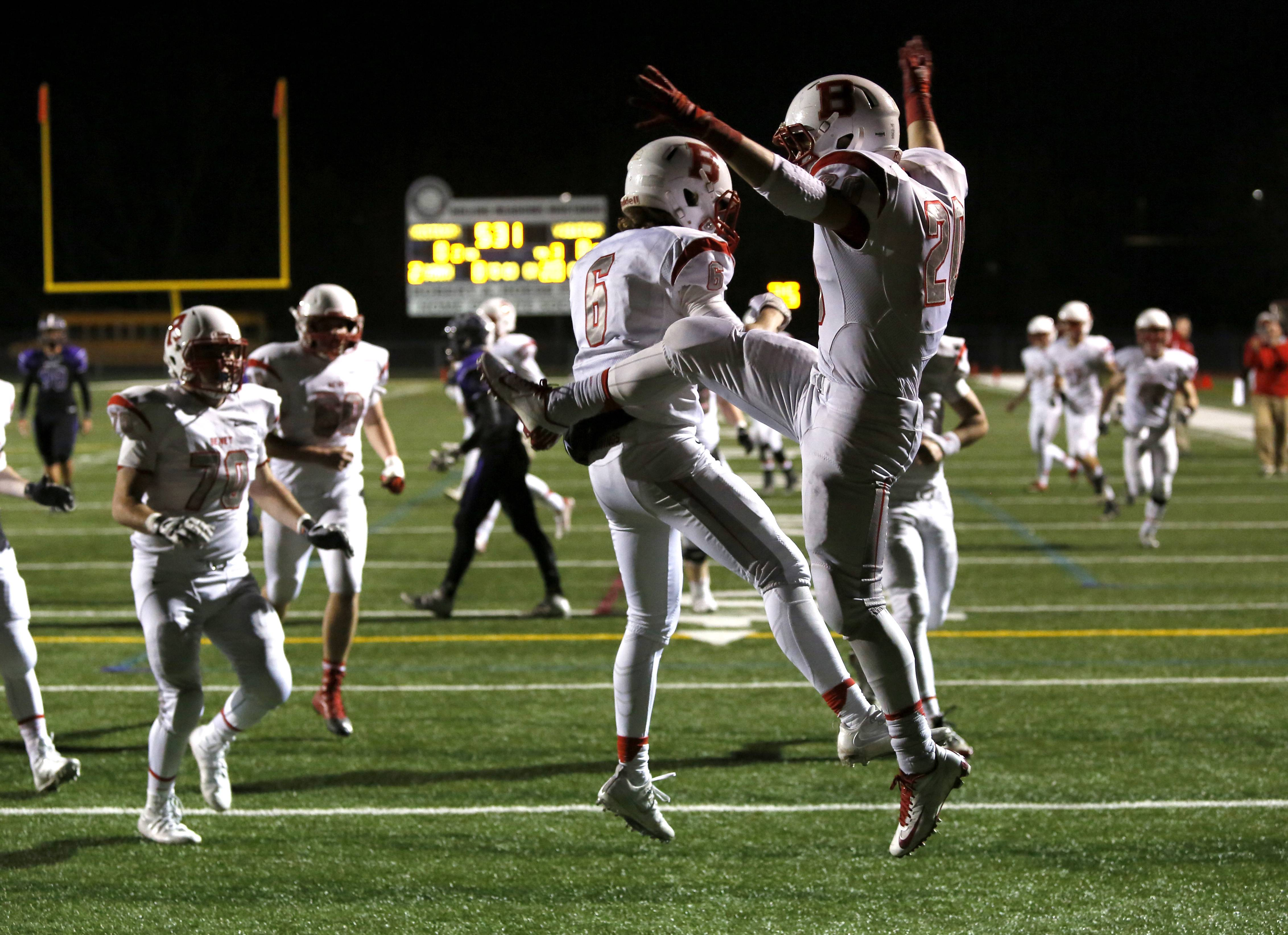 Benet Academy's Marty Dosen, right, celebrates his first-half touchdown catch with Nicholas Keyes, left, against Rolling Meadows during Class 7A football action in Rolling Meadows.