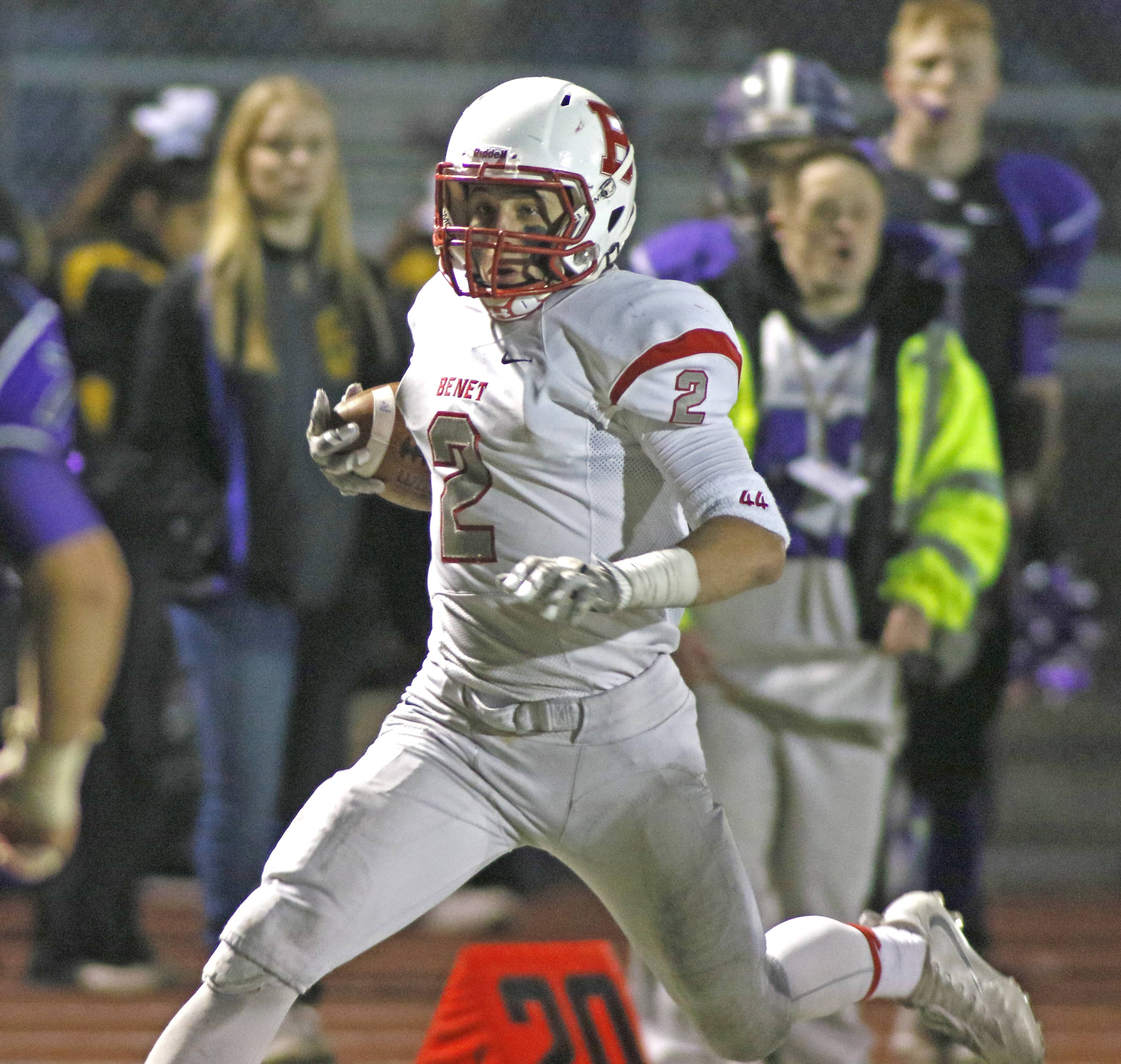 Benet Academy's Danny O'Malley runs back his second-half interception against Rolling Meadows during Class 7A football action in Rolling Meadows.