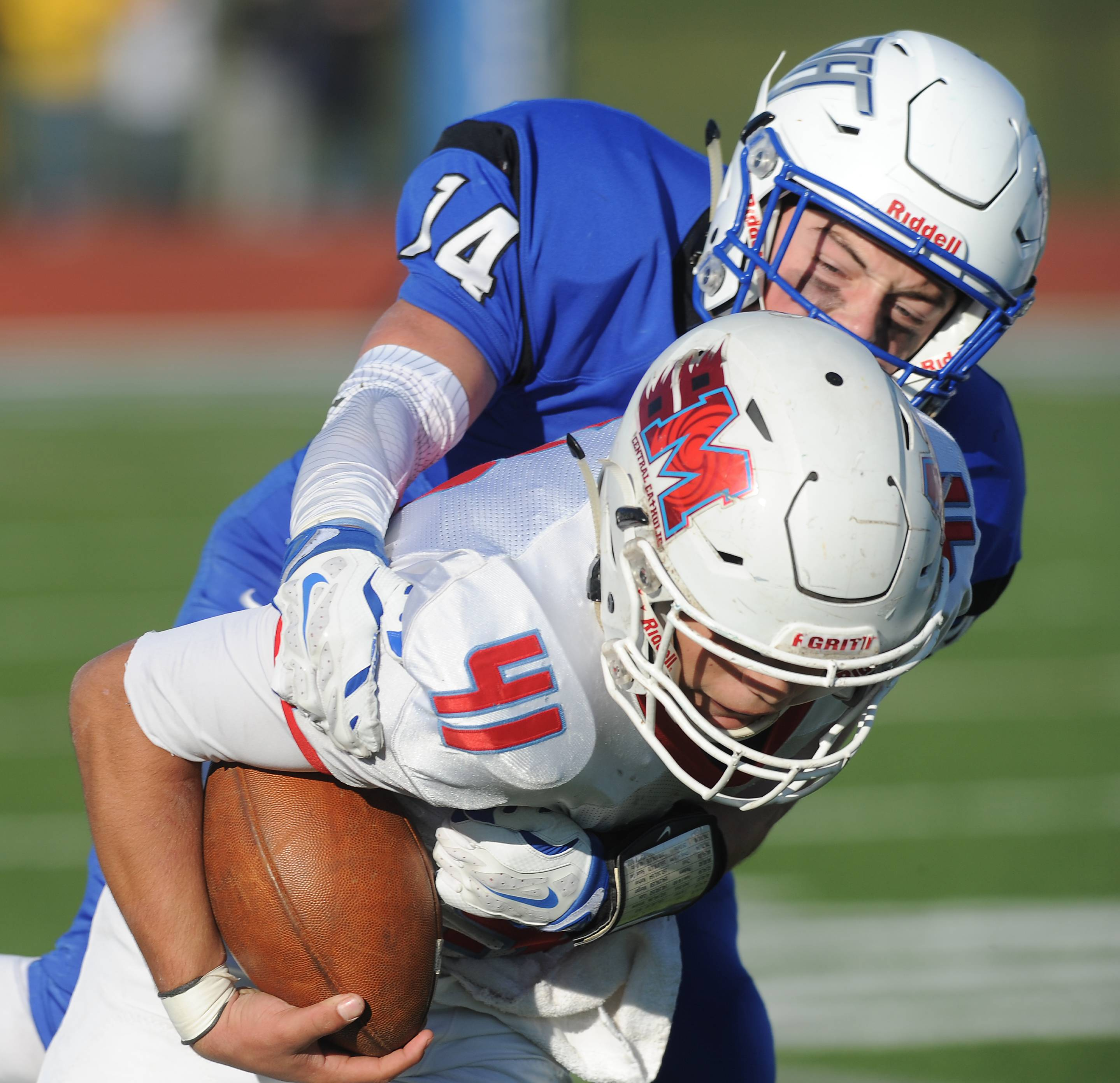 Vernon Hills' Max Lyle wraps up Marian Central Catholic's Patsy Ricciardi in the second half in the Class 5A state quarterfinals at Vernon Hills on Saturday.