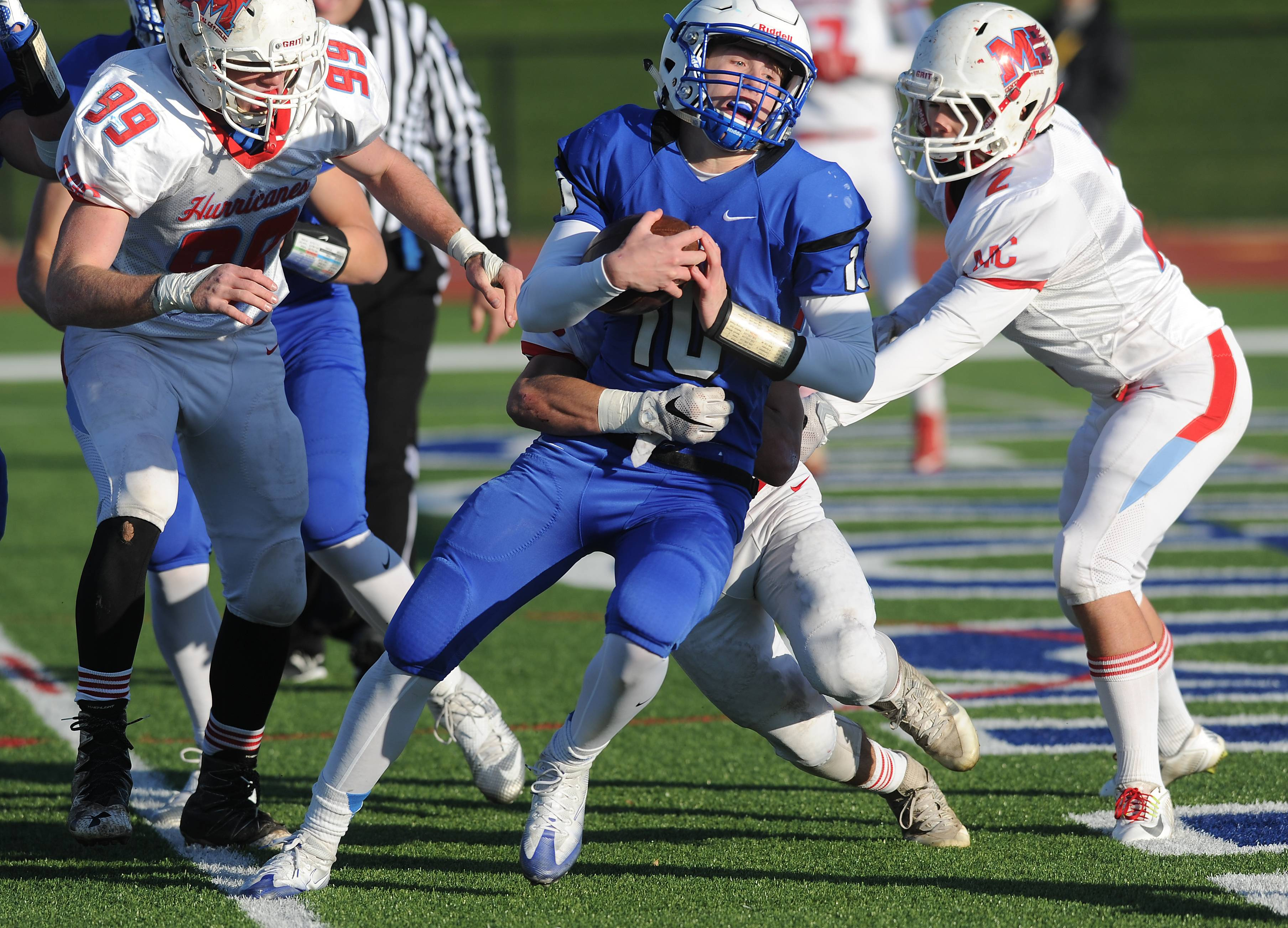 Vernon Hills' Kyle Hull scores in the fourth quarter despite pressure from Marian Central Catholic's defense in the Class 5A state quarterfinals at Vernon Hills on Saturday.