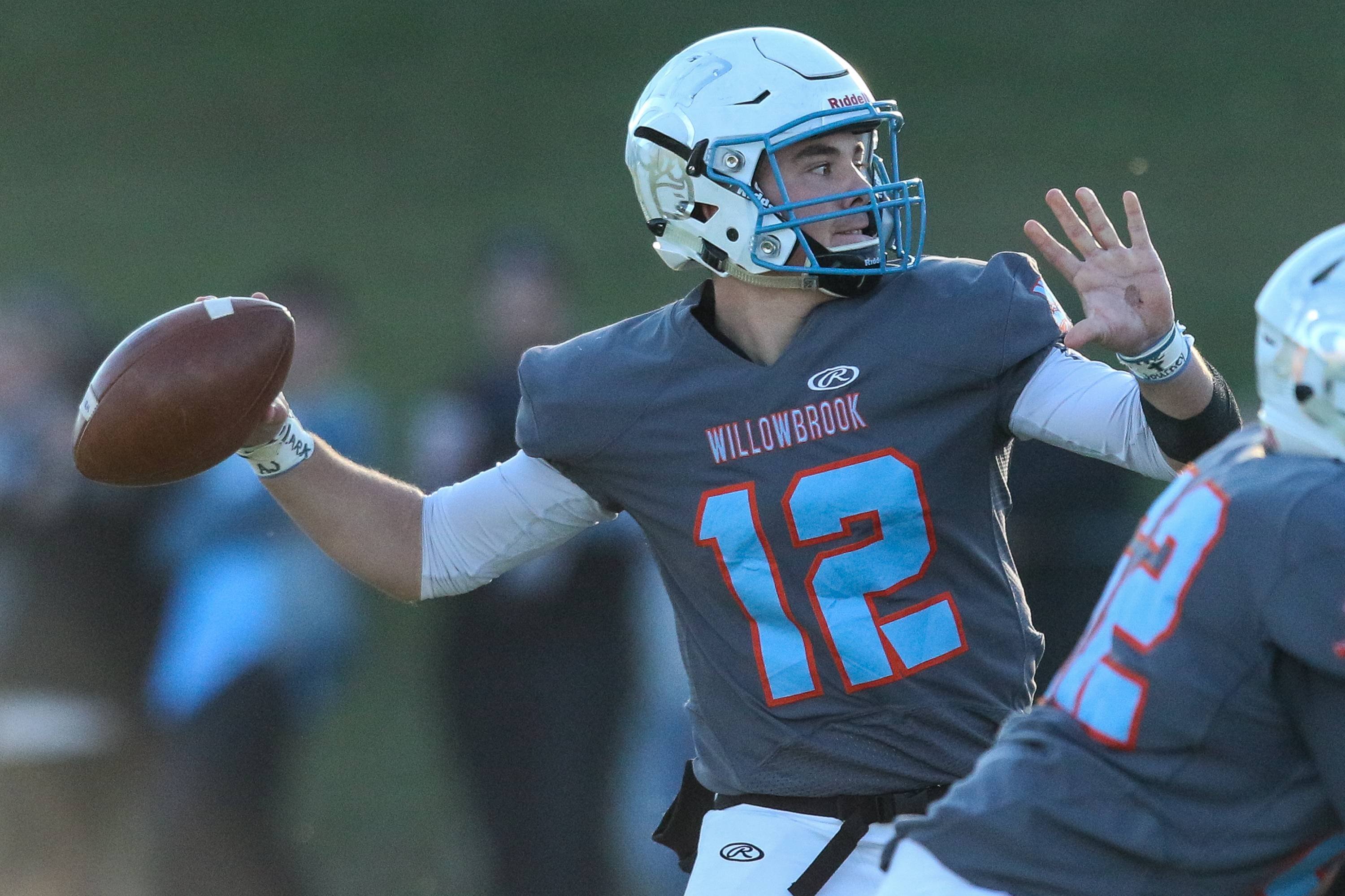 Willowbrook quarterback  M.J. Ranieri (12) throws a pass against East St. Louis during a 7A quarterfinal state playoff game at Willowbrook High School in Villa Park, IL on Saturday, November 12, 2016