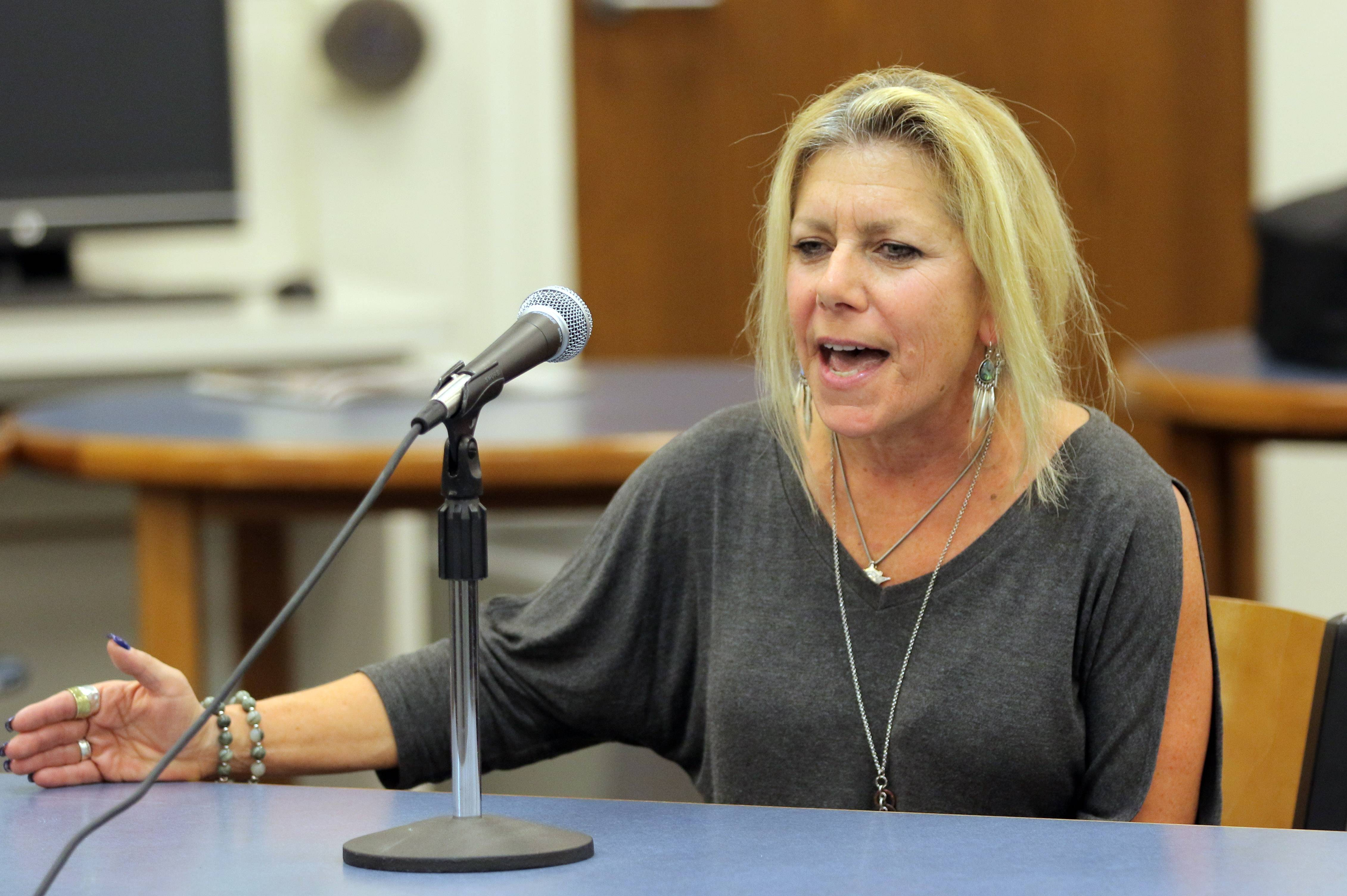 Laurie Stutzman, whose son is a Lake Zurich High School football player, said she supports the team and its coaches, She spoke at Wednesday night's Lake Zurich Unit District 95 board meeting and complimented officials for limiting public information in an effort to protect students' privacy during a football team investigation.