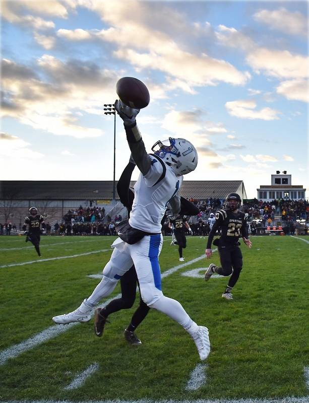 Vernon Hills' Christopher Mariella just misses a grab on the sidelines  under pressure from Sycamore's