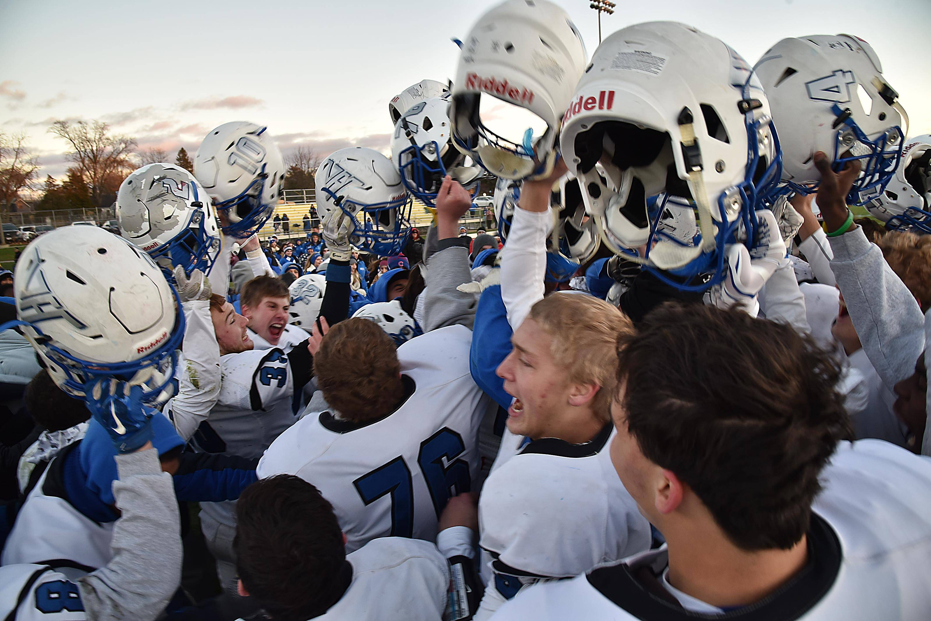 The Vernon Hills Cougars celebrate their win against Sycamore on Saturday in the Class 5A football state semifinals in Sycamore.
