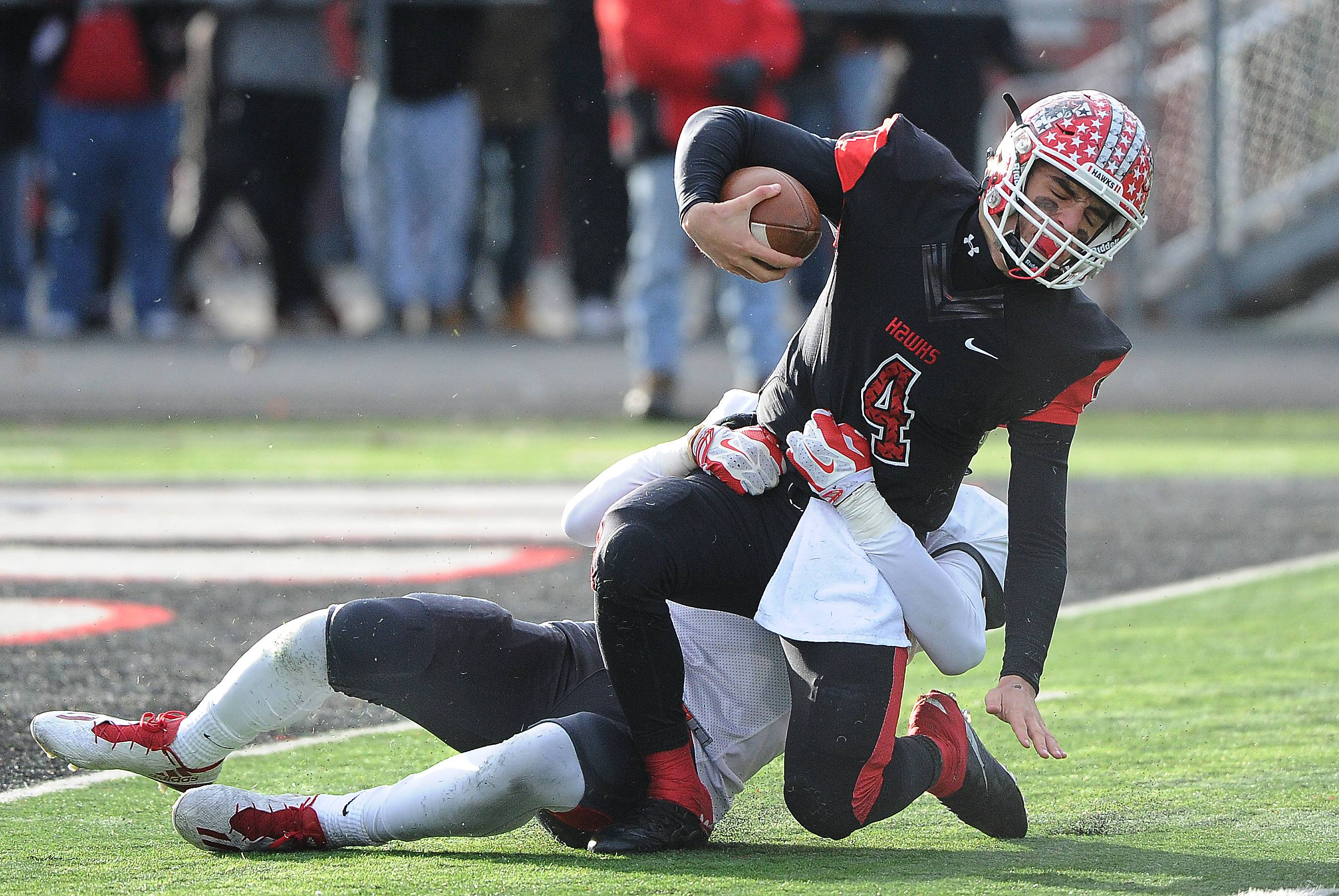 Palatine's Mac Balanganayi sacks Maine South quarterback Nick Leongas in the second quarter on Saturday in Park Ridge.