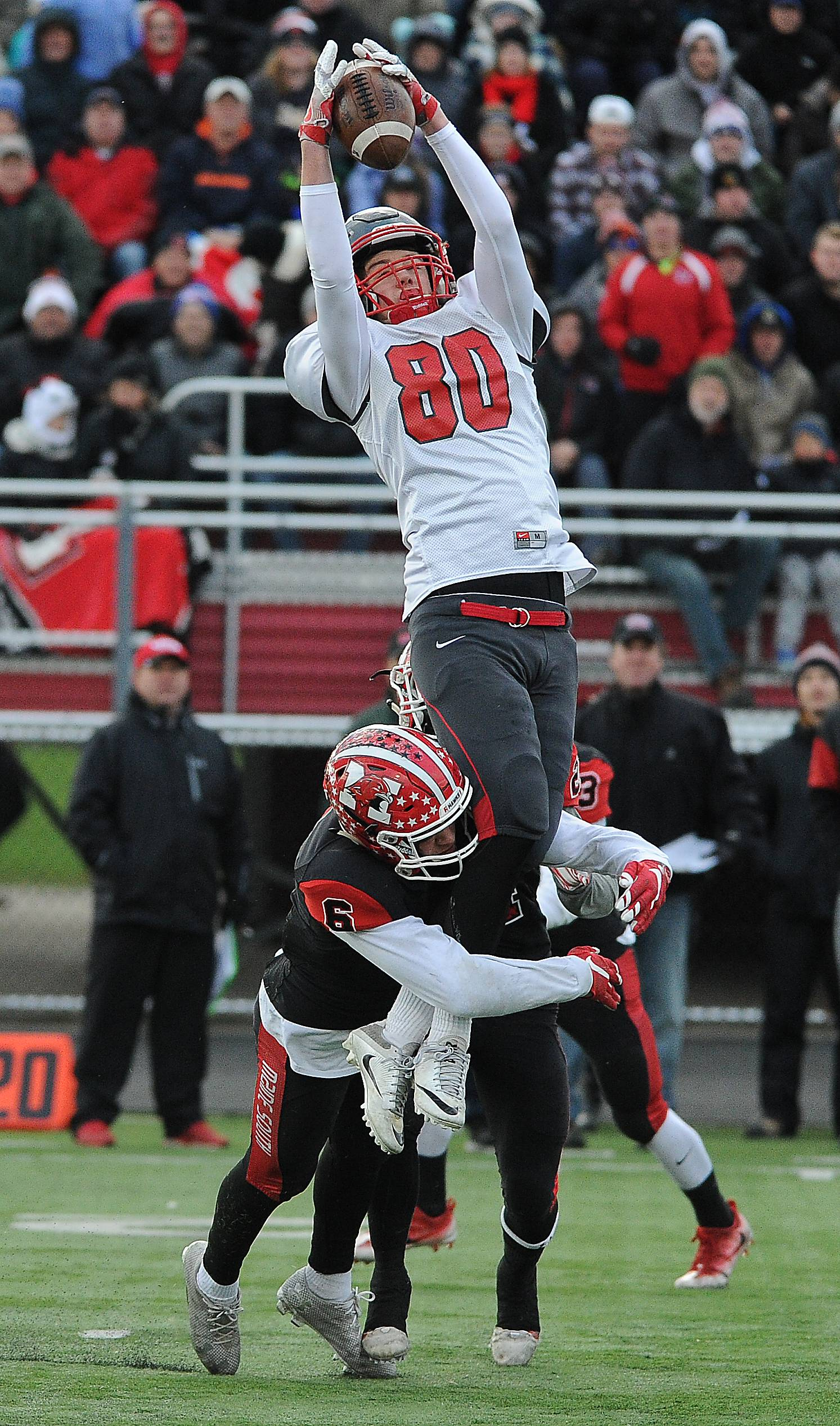 Palatine's Johnny O'Shea soars for a big catch on Saturday at Maine South.