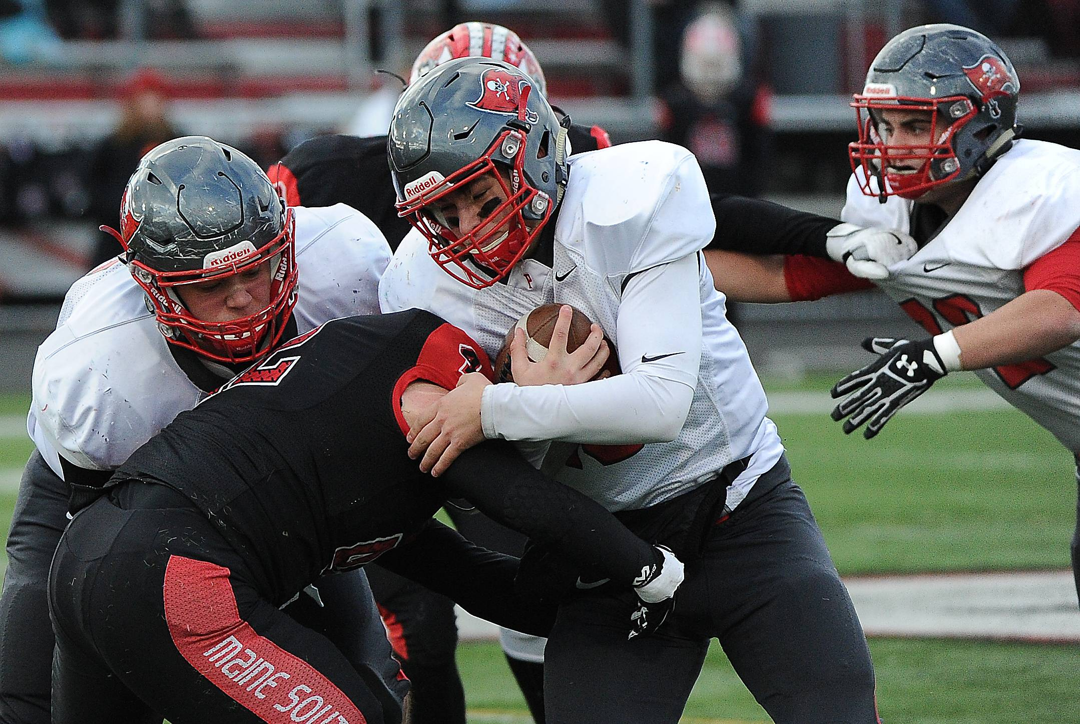 Palatine's quarterback DJ Angelaccio gets jammed up as he runs for yardage in the first half at Maine South.