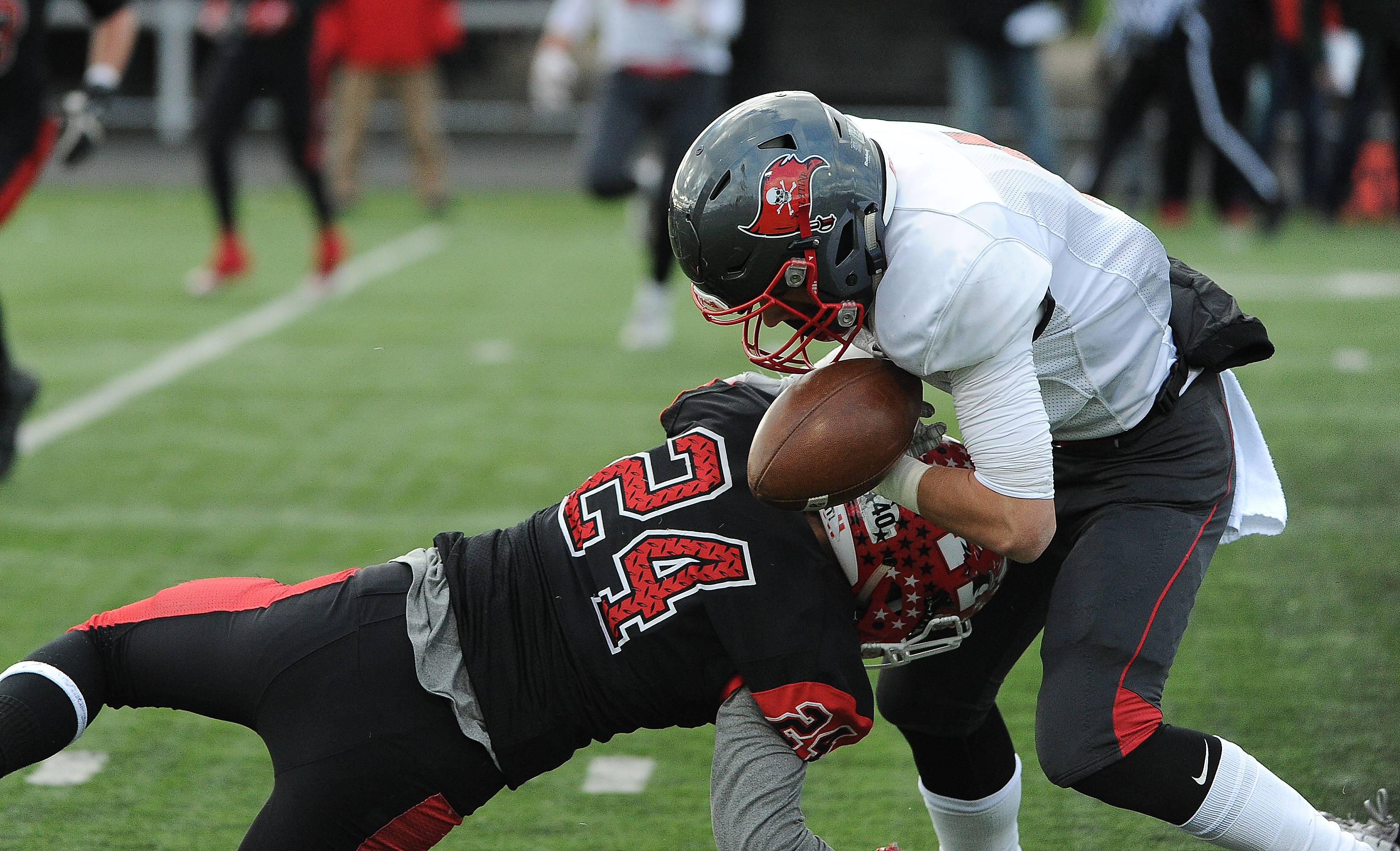 Palatine's Jack Orlando gets popped by Maine South's Matthew Schneider for a fumble during Saturday's Class 8A semifinals.