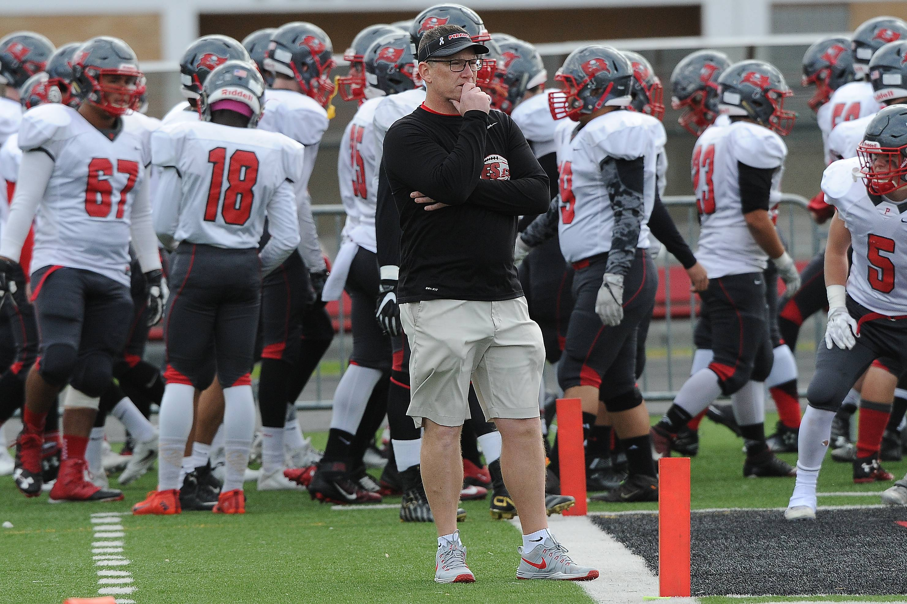 Assistant coach Kevin Garner braved the elements in Palatine's 28-14 loss to Maine South in the Clas 8A state semifinals on Saturday.