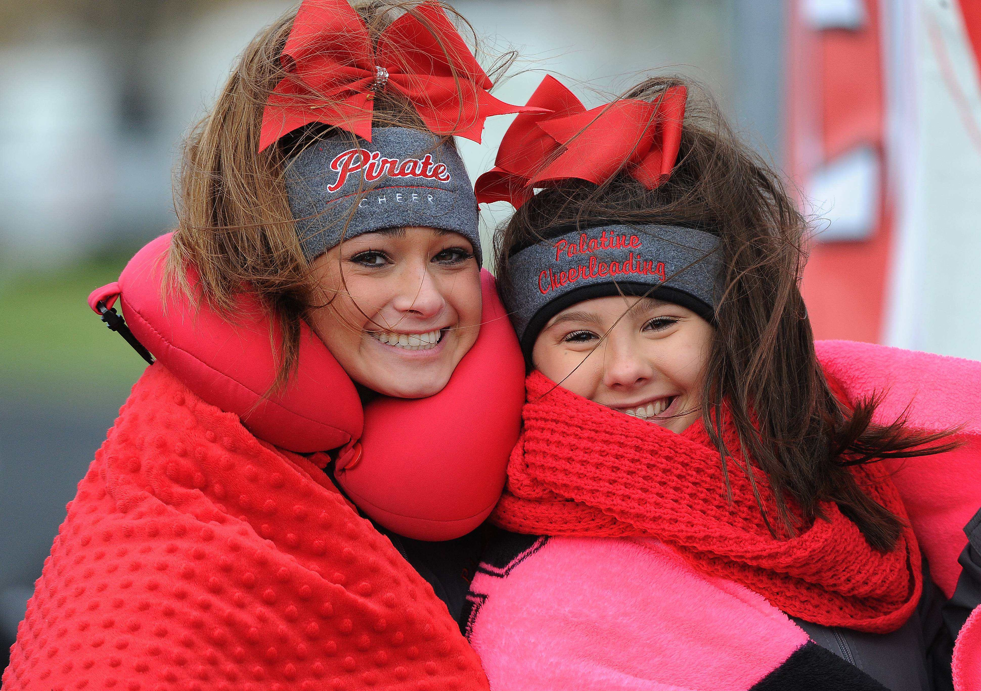 Palatine cheerleaders Haley Azpuru, 17, and Ally Christopher, 14, bundle up in layers before the game, unfortunately Palatine's football season ended with a loss to Maine South 24-7 in the Class 8A semifinals at Maine South High School on Saturday.