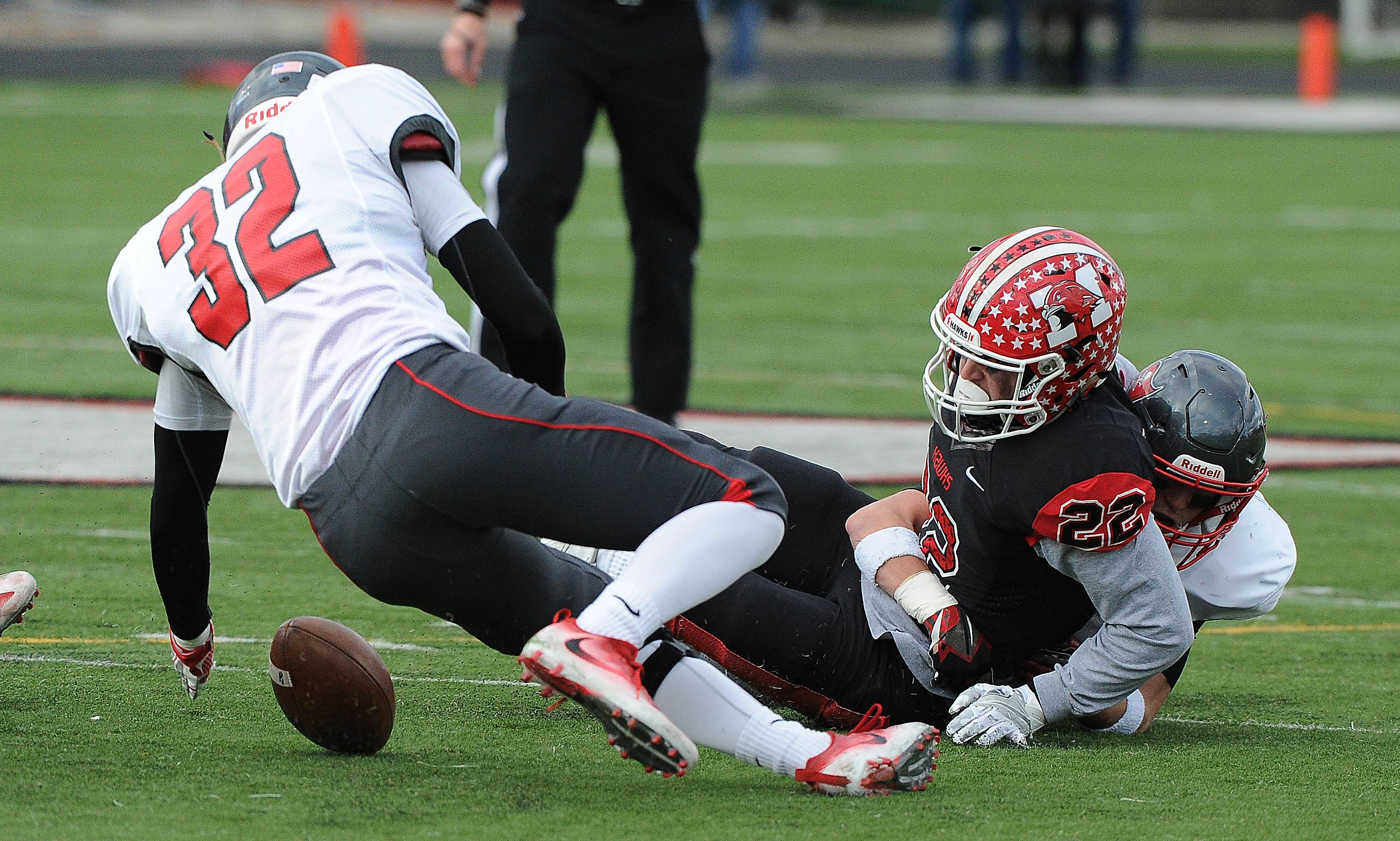 Palatine's Scott Elter can't scoop up a botched punt return fumble by Maine South's Paul Sasso in the first quarter. Palatine's football season ended with a loss to Maine South 28-14 in the Class 8A semifinals in Park Ridge.