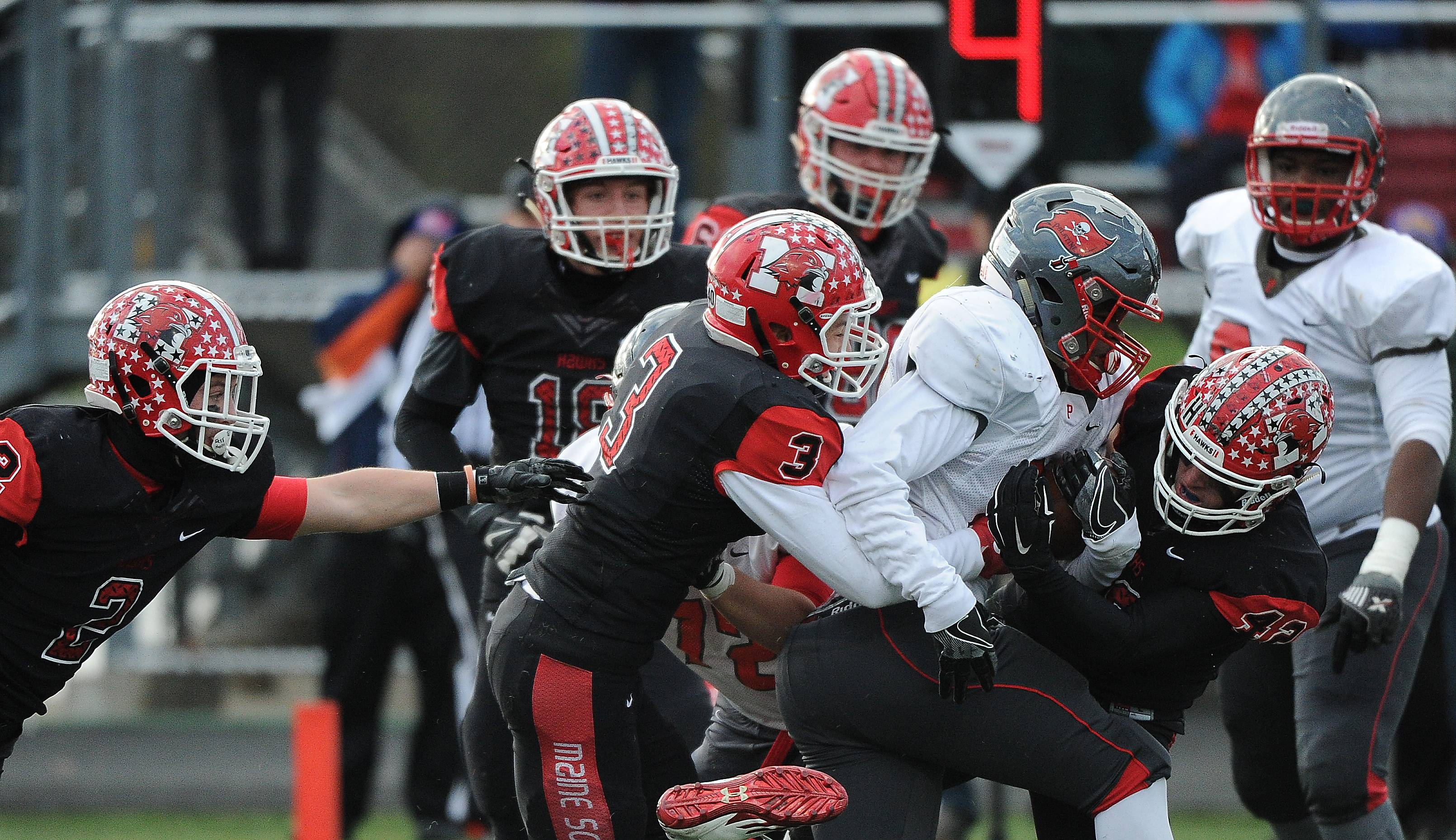 Palatine's Josh Turner is turned away from the end zone by a tough Maine South defense in Class 8A semifinal action. The Hawks face Loyola for the Class 8A state championship Saturday in Champaign.