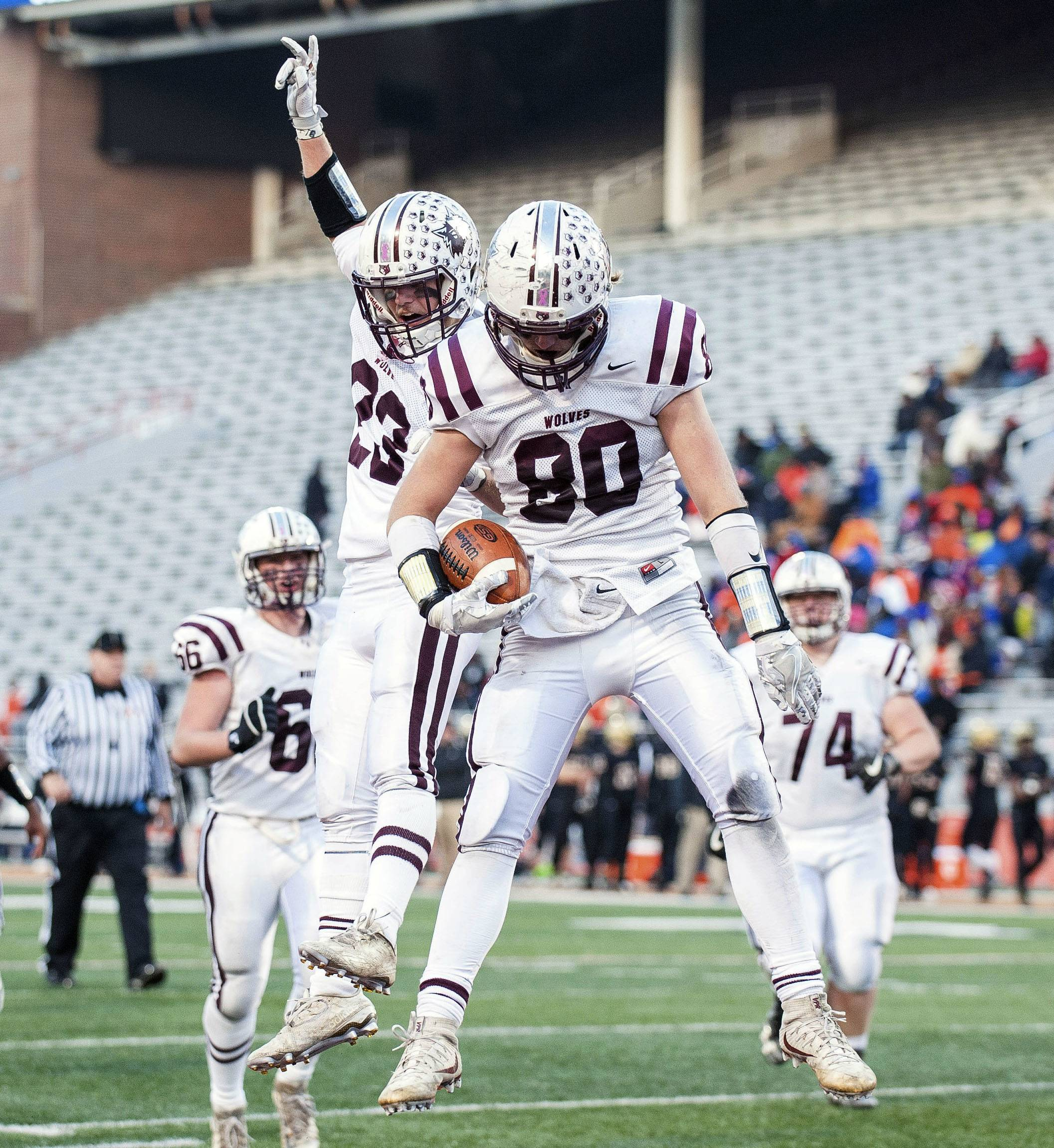 Prairie Ridge's Cole Brown (23) celebrates Austen Ferbet's touchdown reception during the fourth quarter of the Class 6A high school football state championship game against Springfield Sacred Heart-Griffin on Saturday at Memorial Stadium in Champaign.