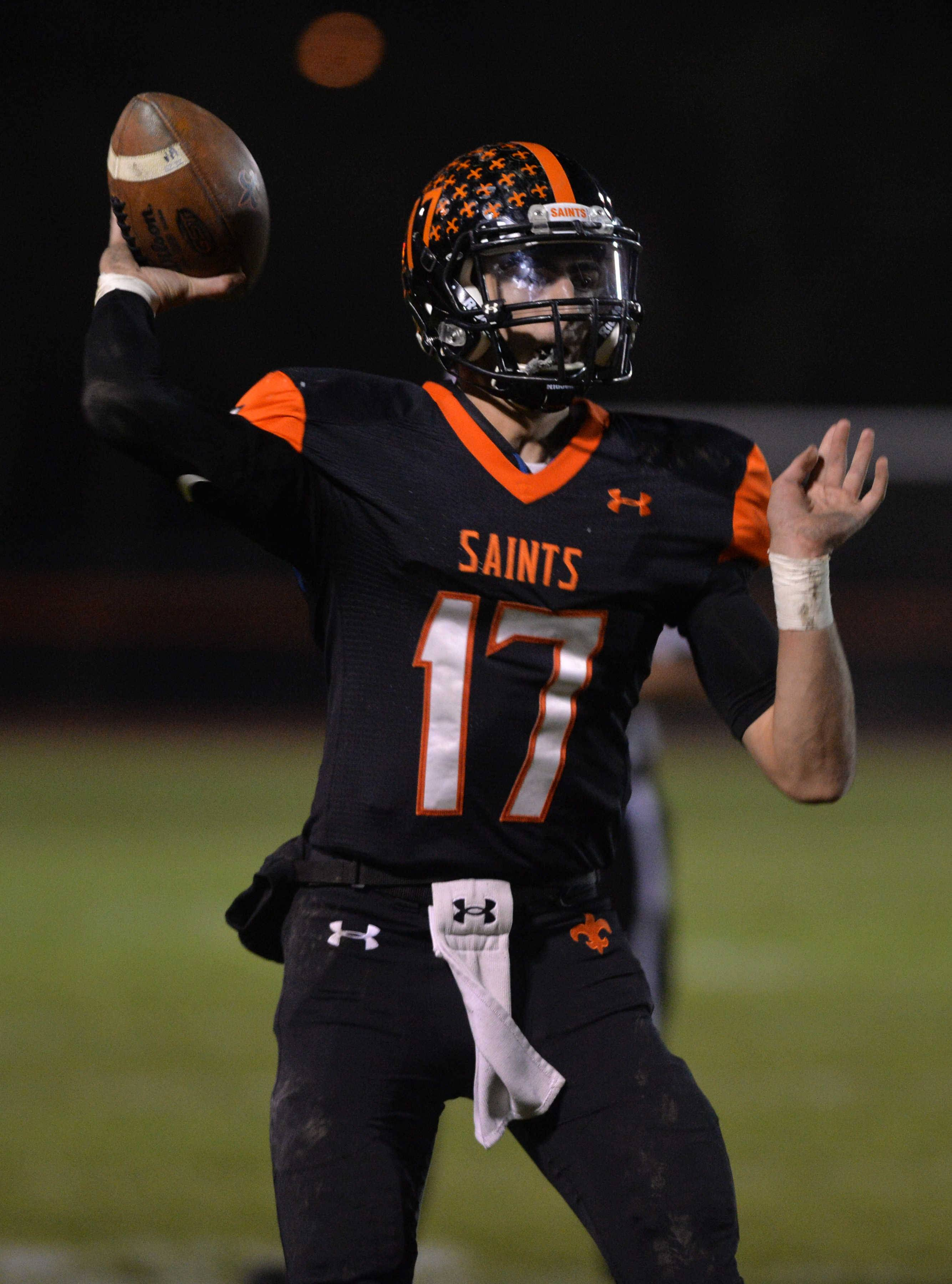 St. Charles East quarterback Zach Mitchell, the 2016 captain of the Daily Herald's Fox Valley All-Area Football Team. passes in the first quarter of a Class 8A playoff win over Lockport.