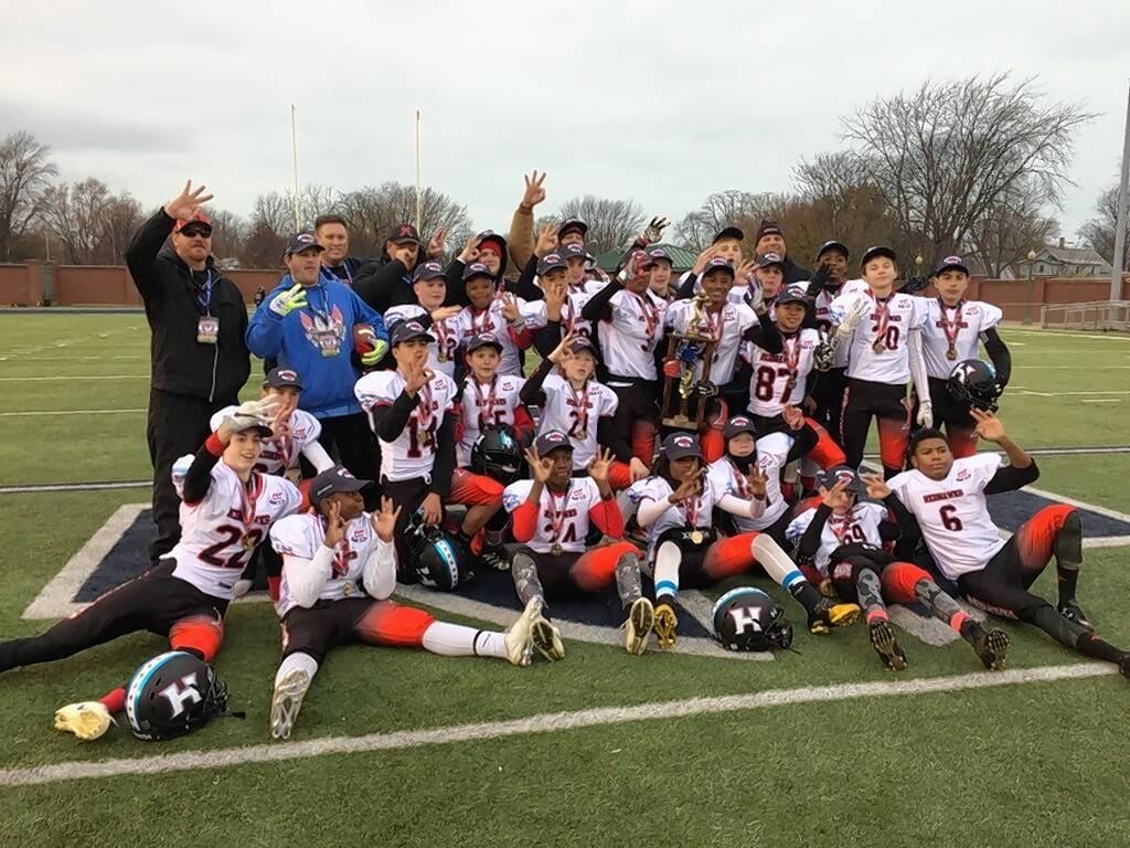 The Hoffman Estates Redhawks on Friday won their third consecutive Pop Warner Division II Pee Wee National Championship in Orlando, Florida.