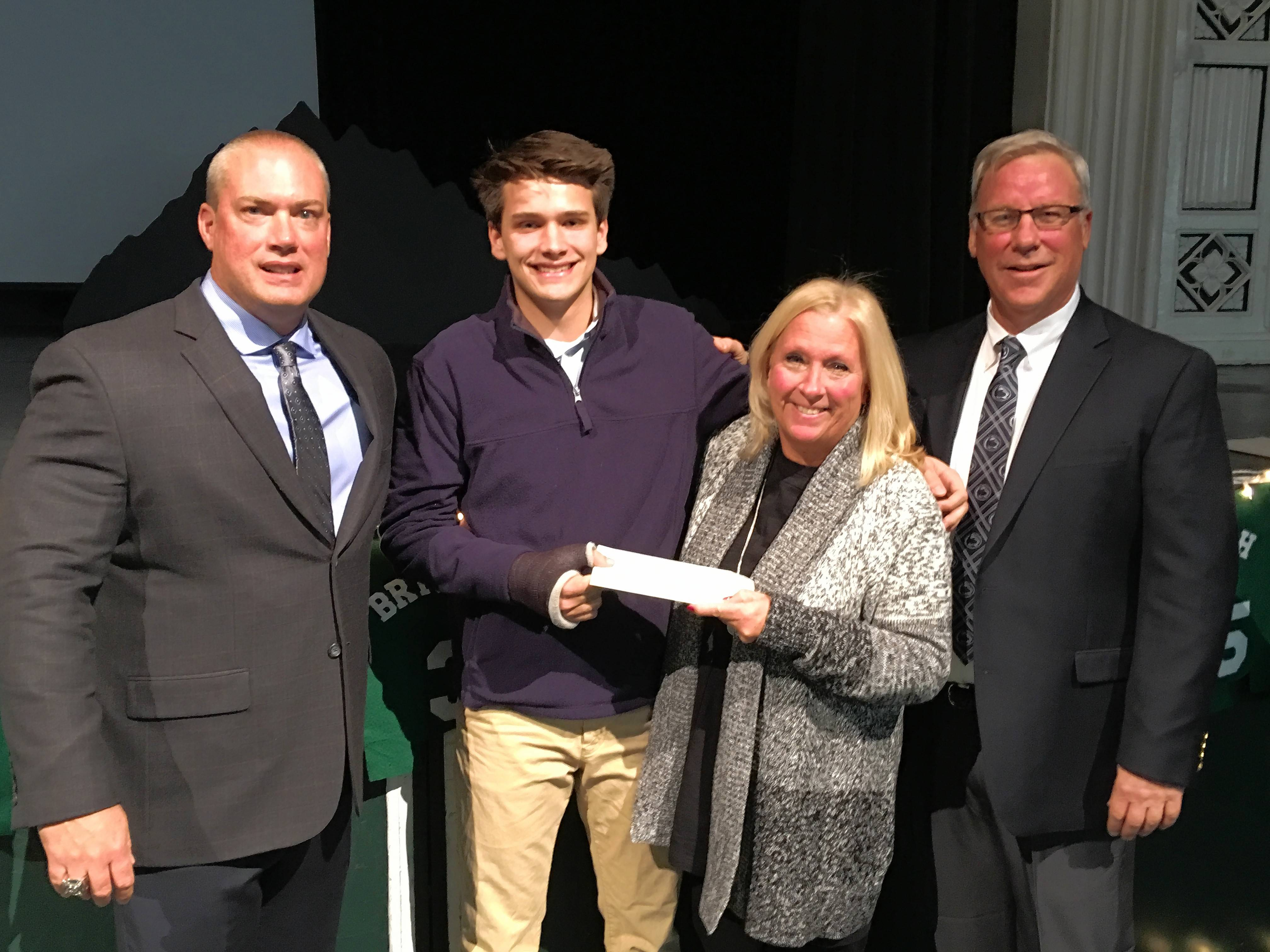 Yanni Pappas is presented the Andrew Garwood STRONG Foundation scholarship at Glenbard West's football banquet last weekend. From left are Glenbard West football coach Chad Hetlet, Yanni Pappas, Terri and Steve Garwood.