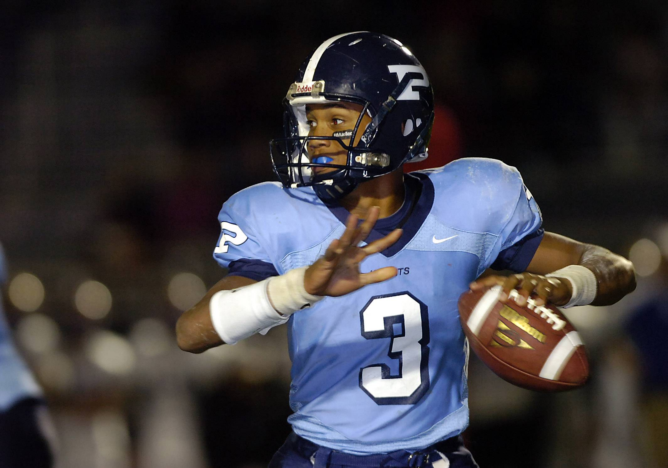 Miles Osei, shown here during his days as an all-state quarterback at Prospect, is now the football head coach at Elk Grove.