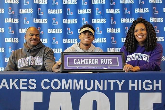 Lakes' Cameron Ruiz, flanked by parents Joseph and Melanie, has a future in the defensive backfield at Northwestern.