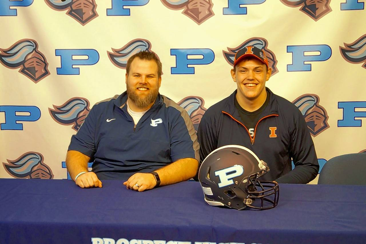 Illinois-bound offensive lineman Alex Palczewski, right, and Prospect offensive line coach Tim Beishir.