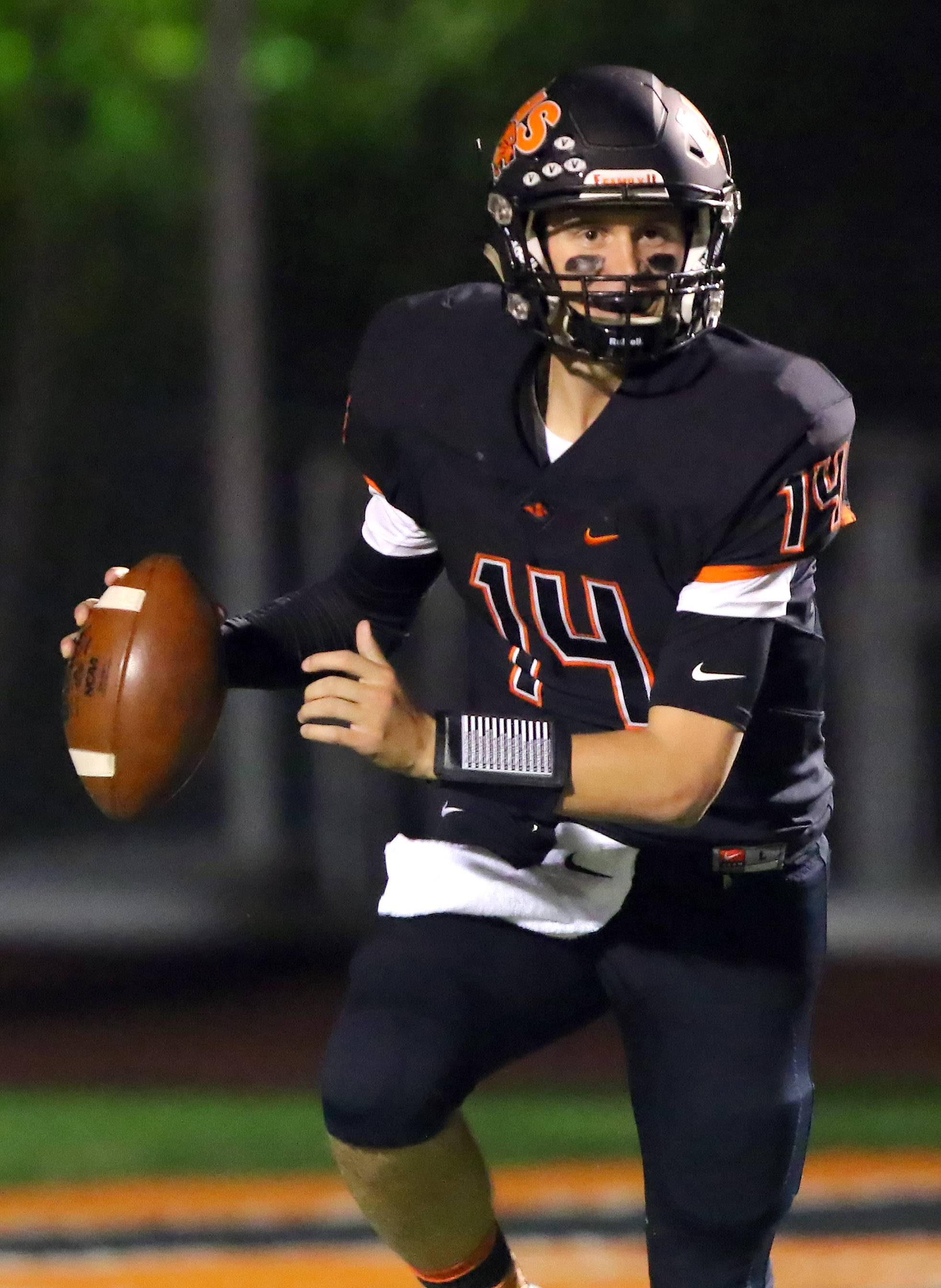 Libertyville's Jack Ruskell, here looking to deliver a pass against Lake Zurich, will be a priority walk-on at Alabama.