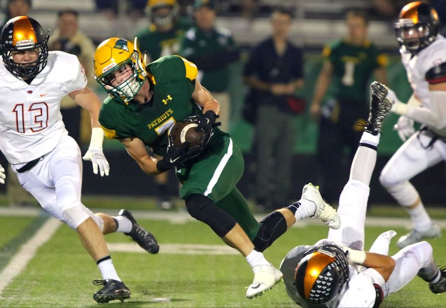 Stevenson's Henry Marchese, here on the run following a catch against Libertyville, will become part of the football landscape at Iowa next fall.