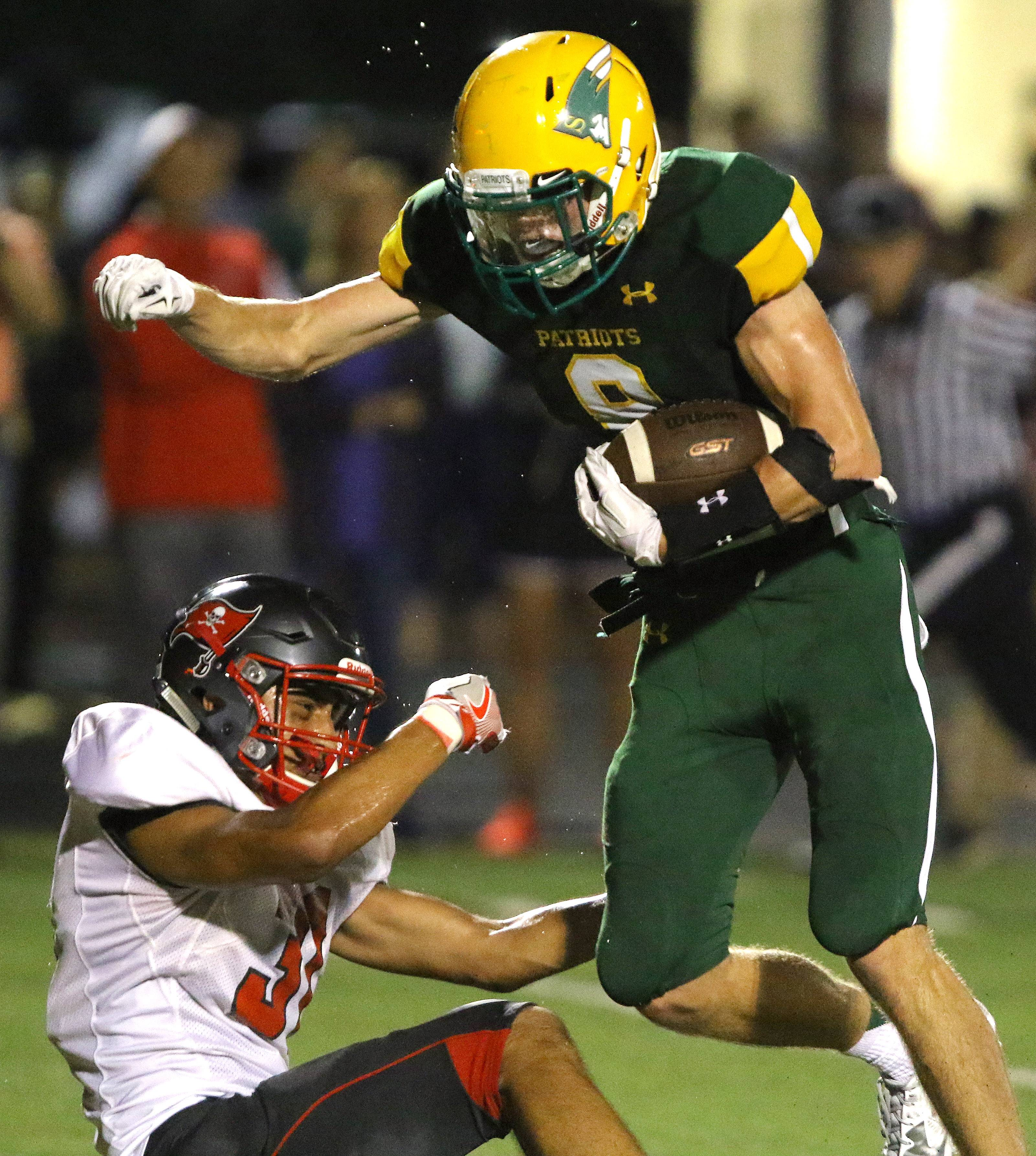 Stevenson's Michael Marchese, at right as Palatine's Dylan Tapia tries to make the tackle, has a football future awaiting him at Illinois.
