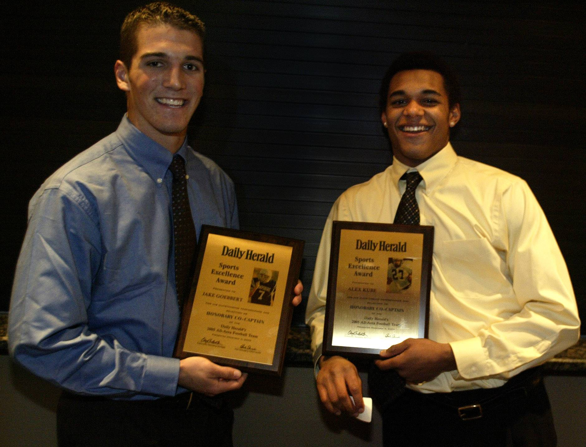 2005 Daily Herald/Fox Valley All-area football captains Jake Goebbert of Hampshire, left, Alex Kube of Cary-Grove pose with their awards at the all-area recognition banquet.
