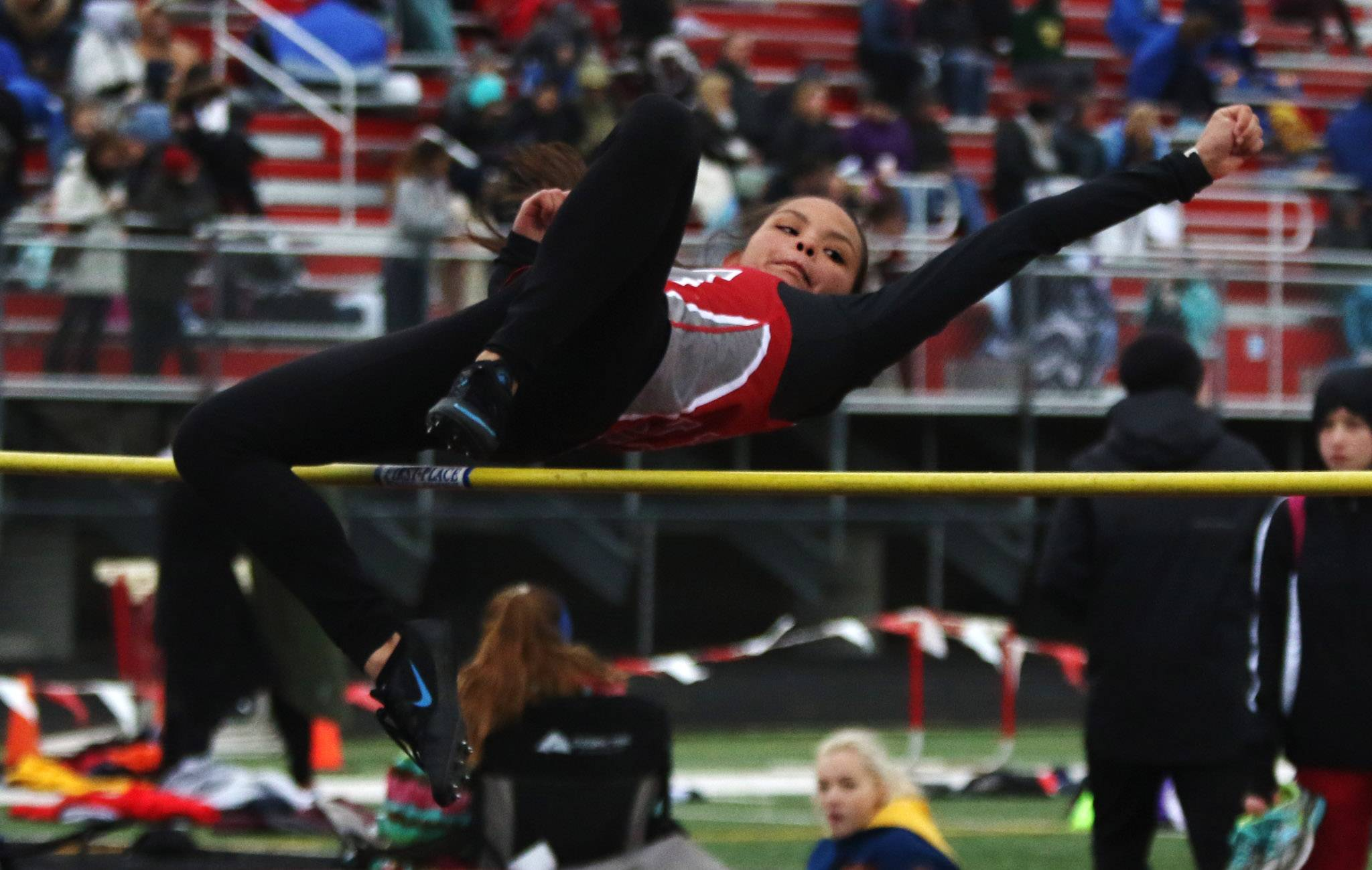 Mundelein high jumper Ryann Ray clears the bar during the Lake County girls track meet Thursday at Deerfield.