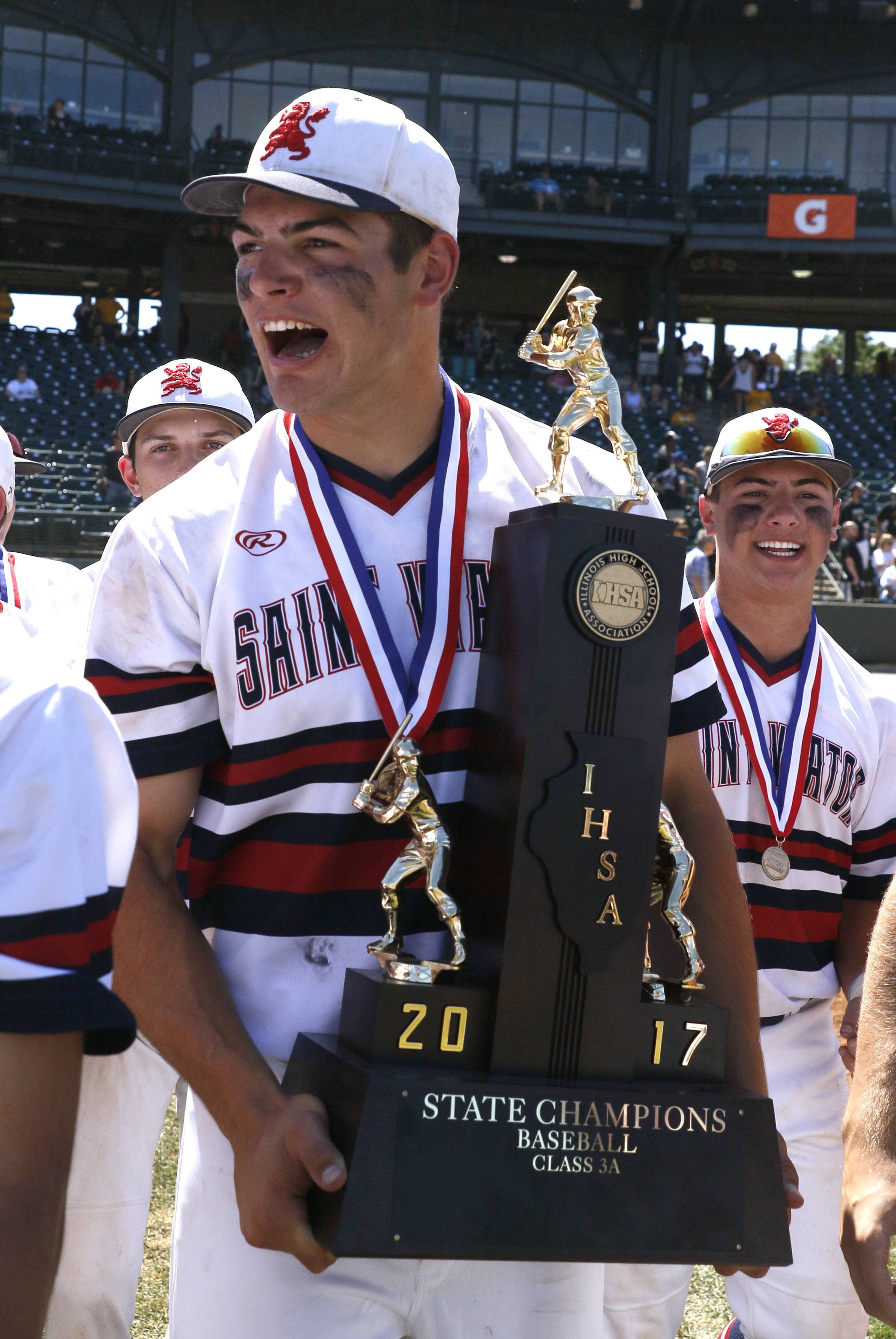 St. Viator senior Cole Kmet hoists the Class 3A baseball state championship trophy after Saturday's 10-8 win over Marian Catholic on Saturday in Joliet.