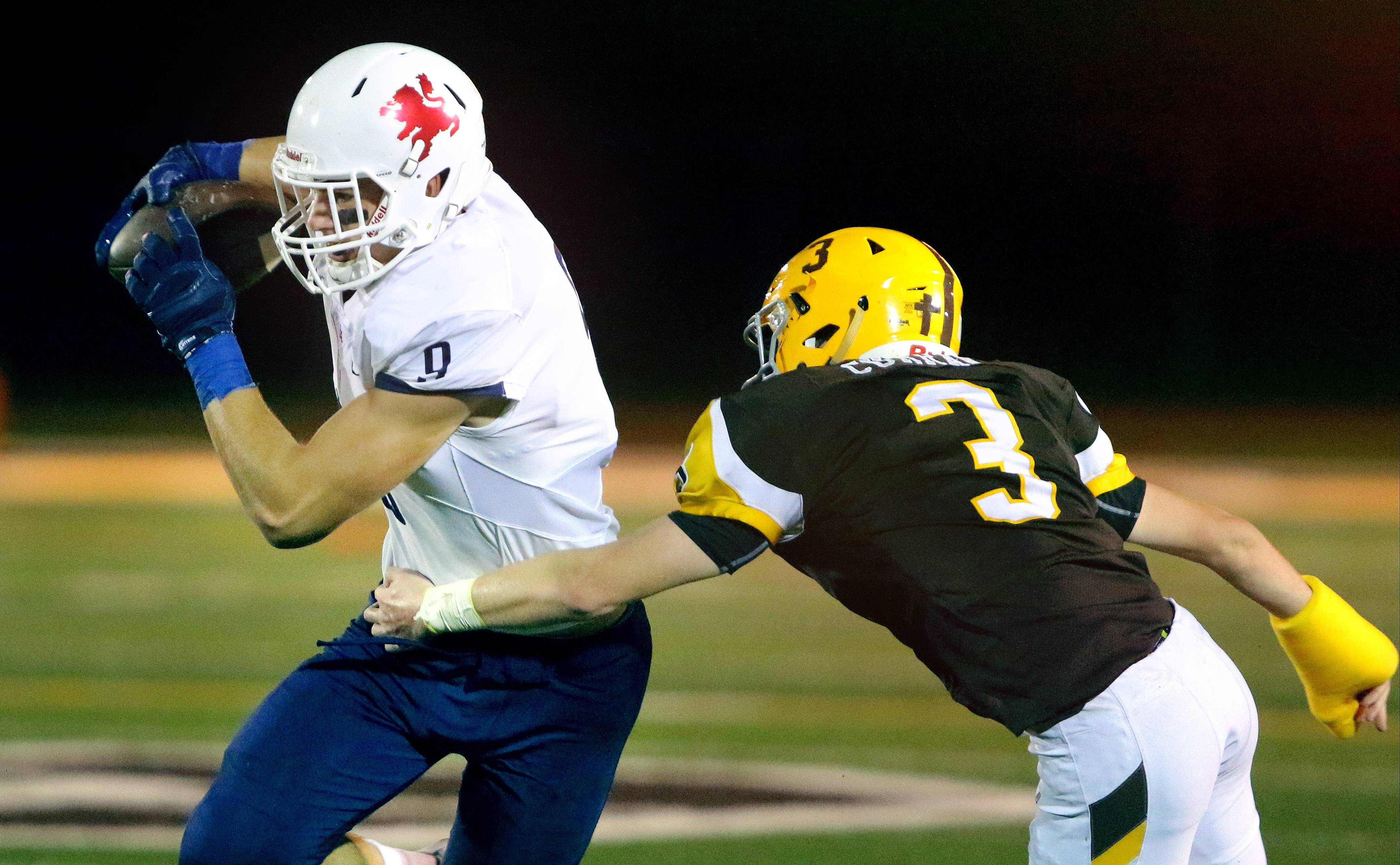Cole Kmet, left, excelled both as a blocking and pass-catching tight end at St. Viator.