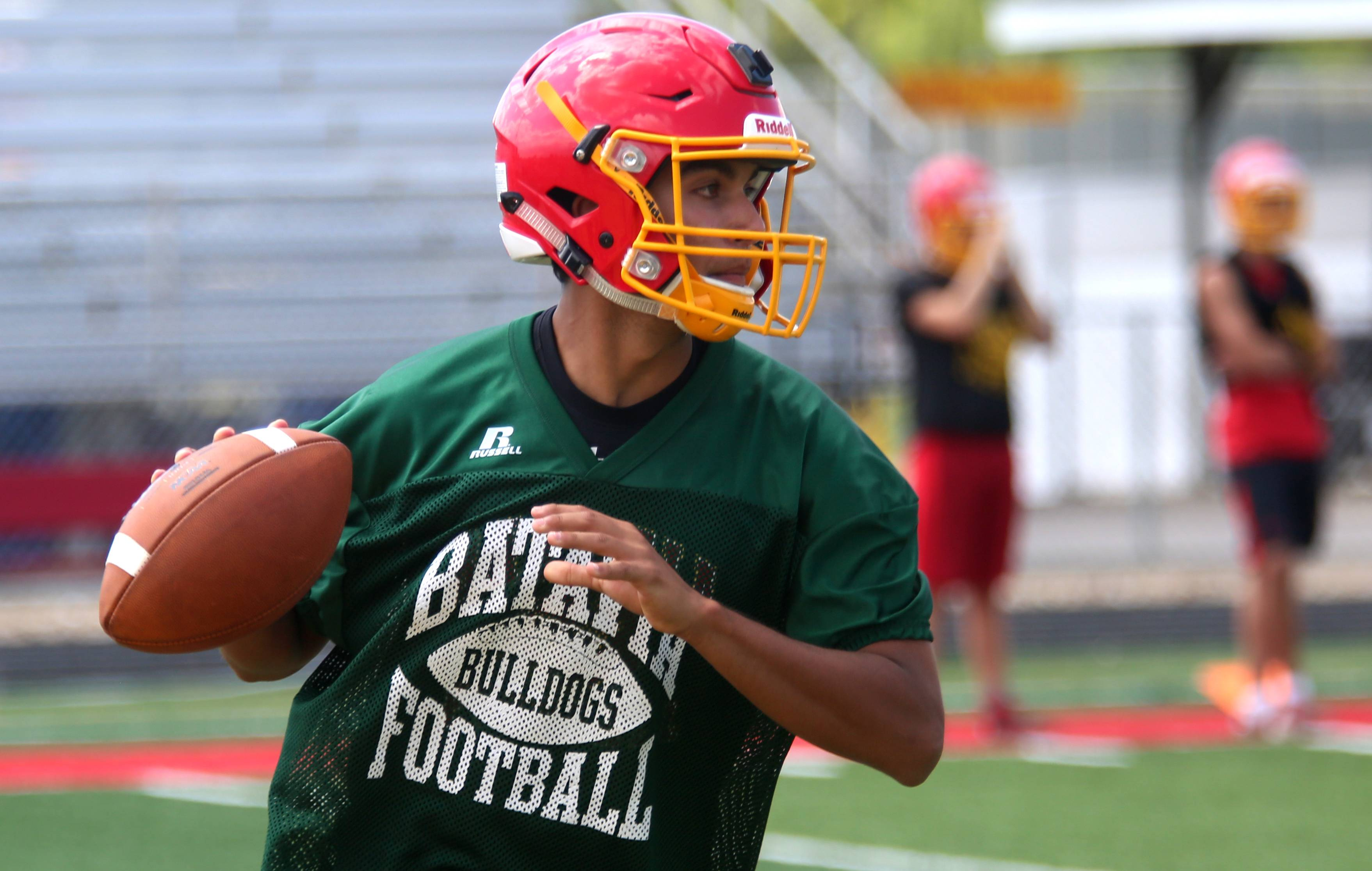 Riley Cooper prepares to throw the ball during the first day of the varsity practice season for Batavia High School football at Bulldog Stadium in Batavia Monday.