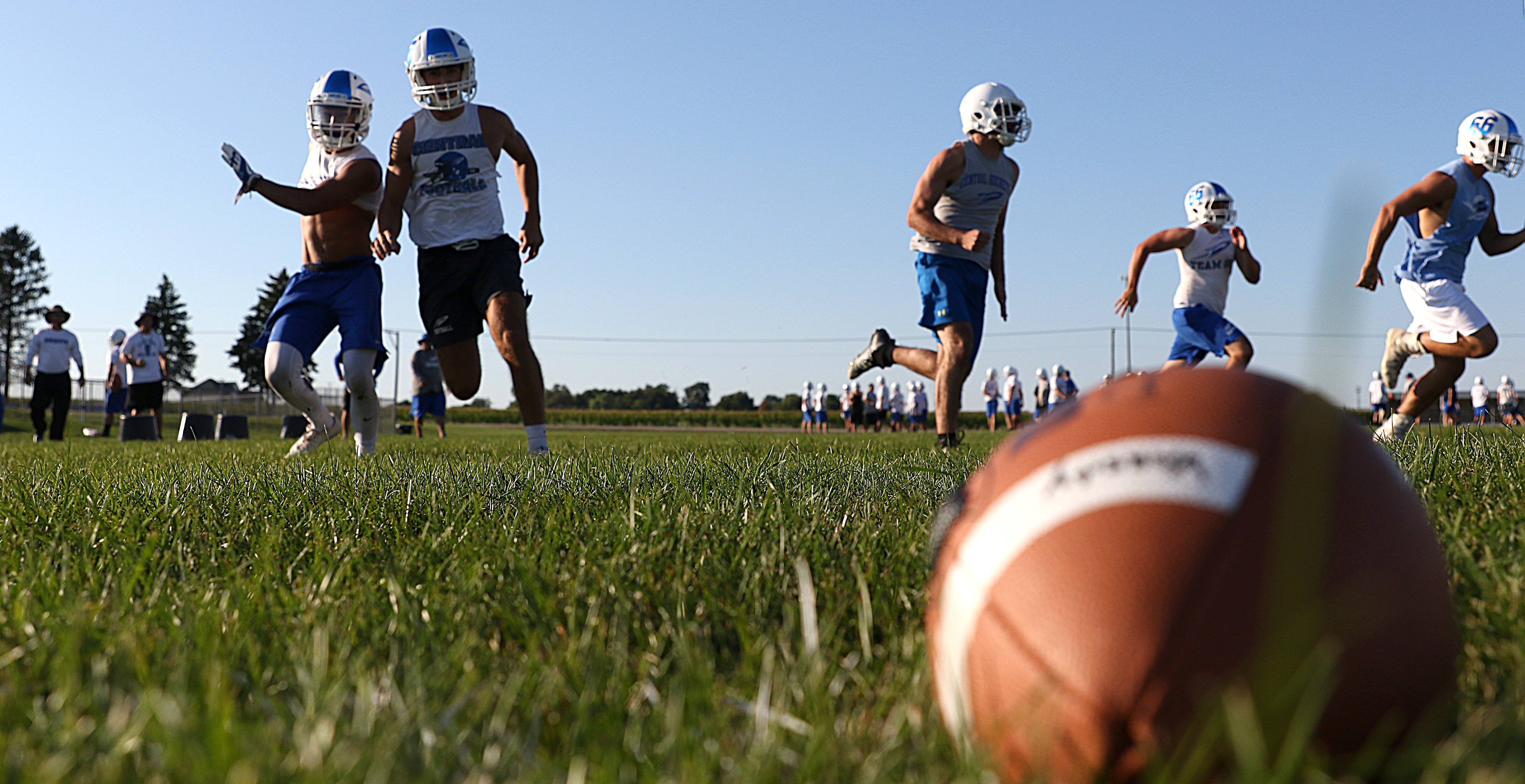 Rockets hustle through a drill on the first day of practice for Burlington Central High School varsity football for 2017.