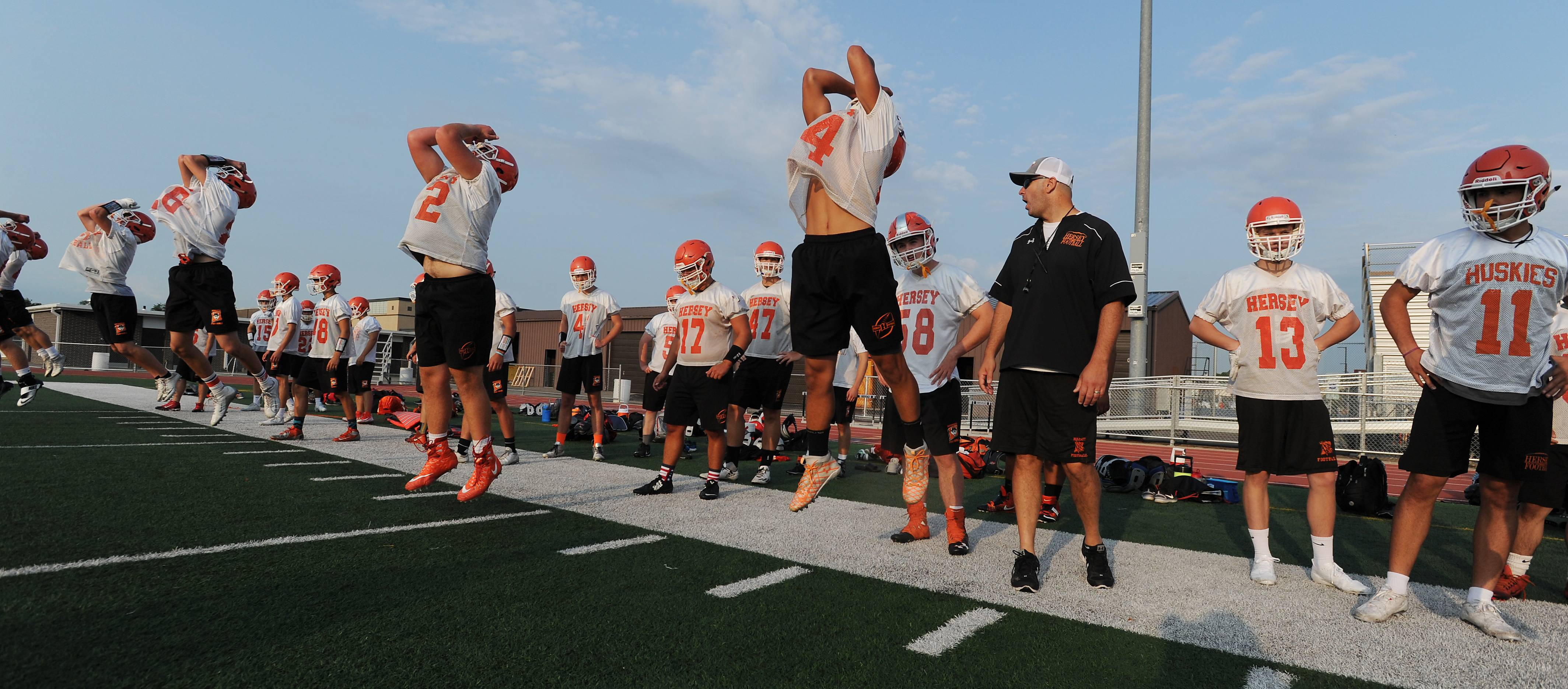 Hersey football head coach Joe Pardun gets his players going in Monday's early morning workout.