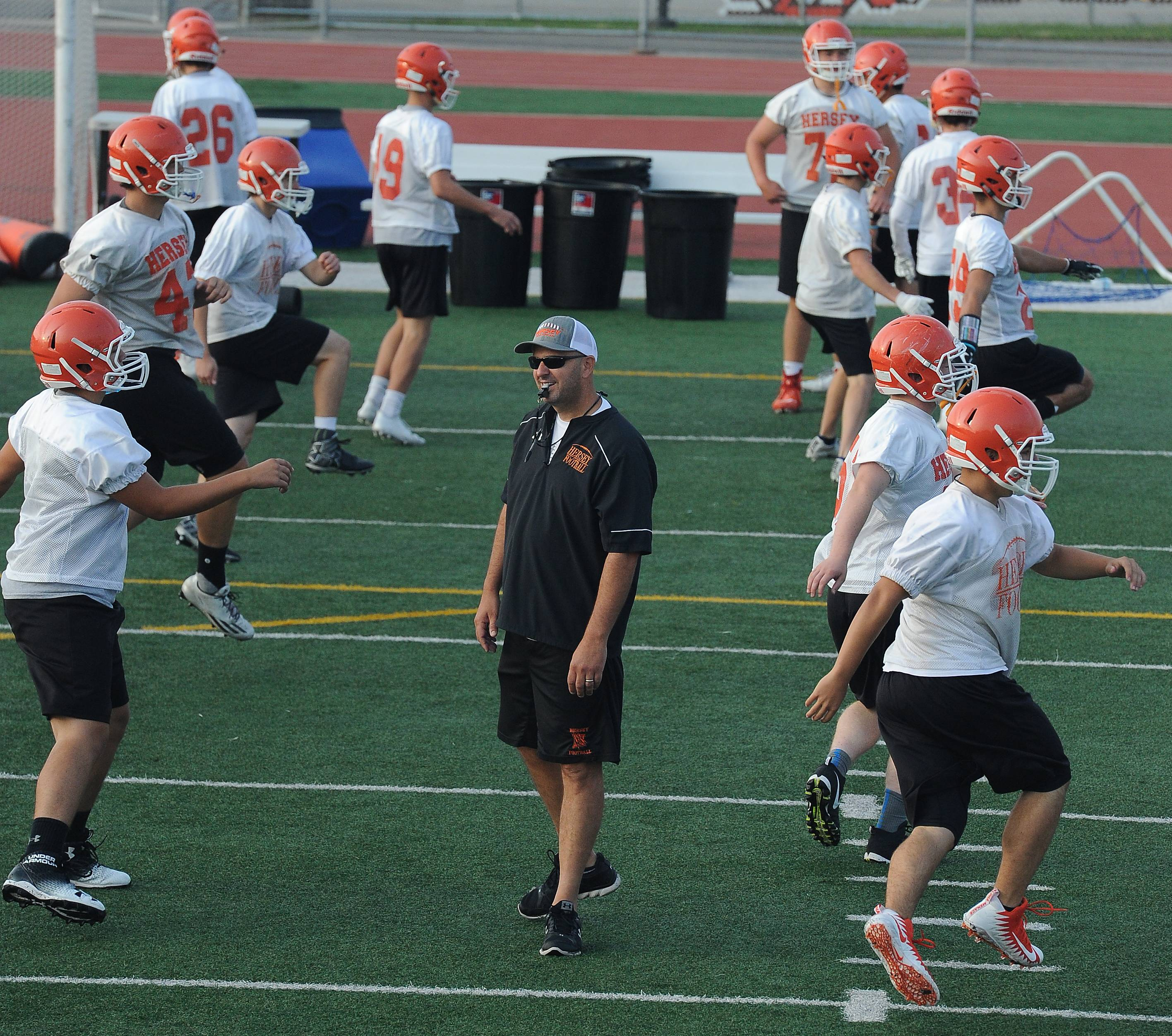 Hersey football head coach Joe Pardun with his players in the early morning workout session Monday.