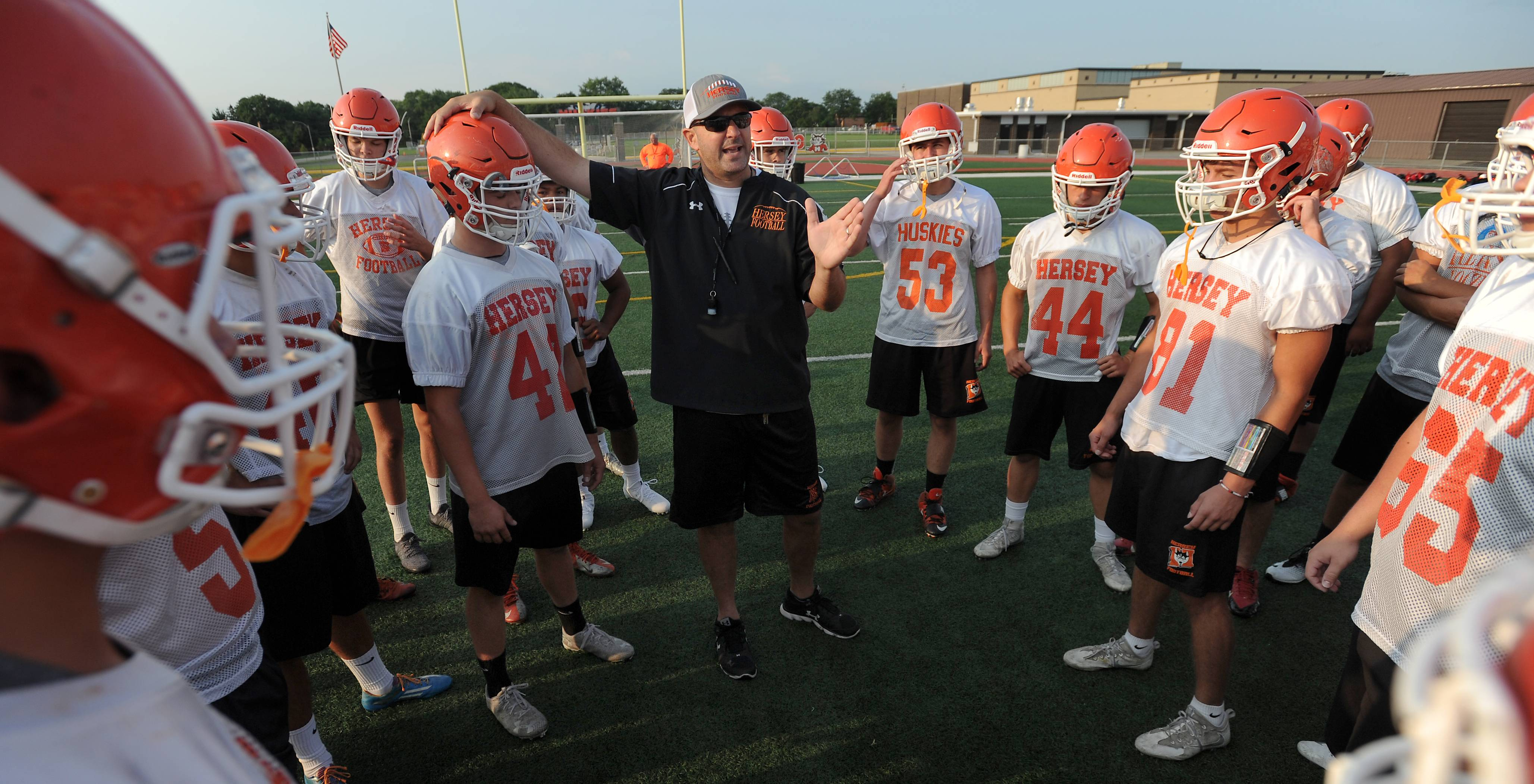 Hersey football head coach Joe Pardun with his players in an early morning workout session Monday.