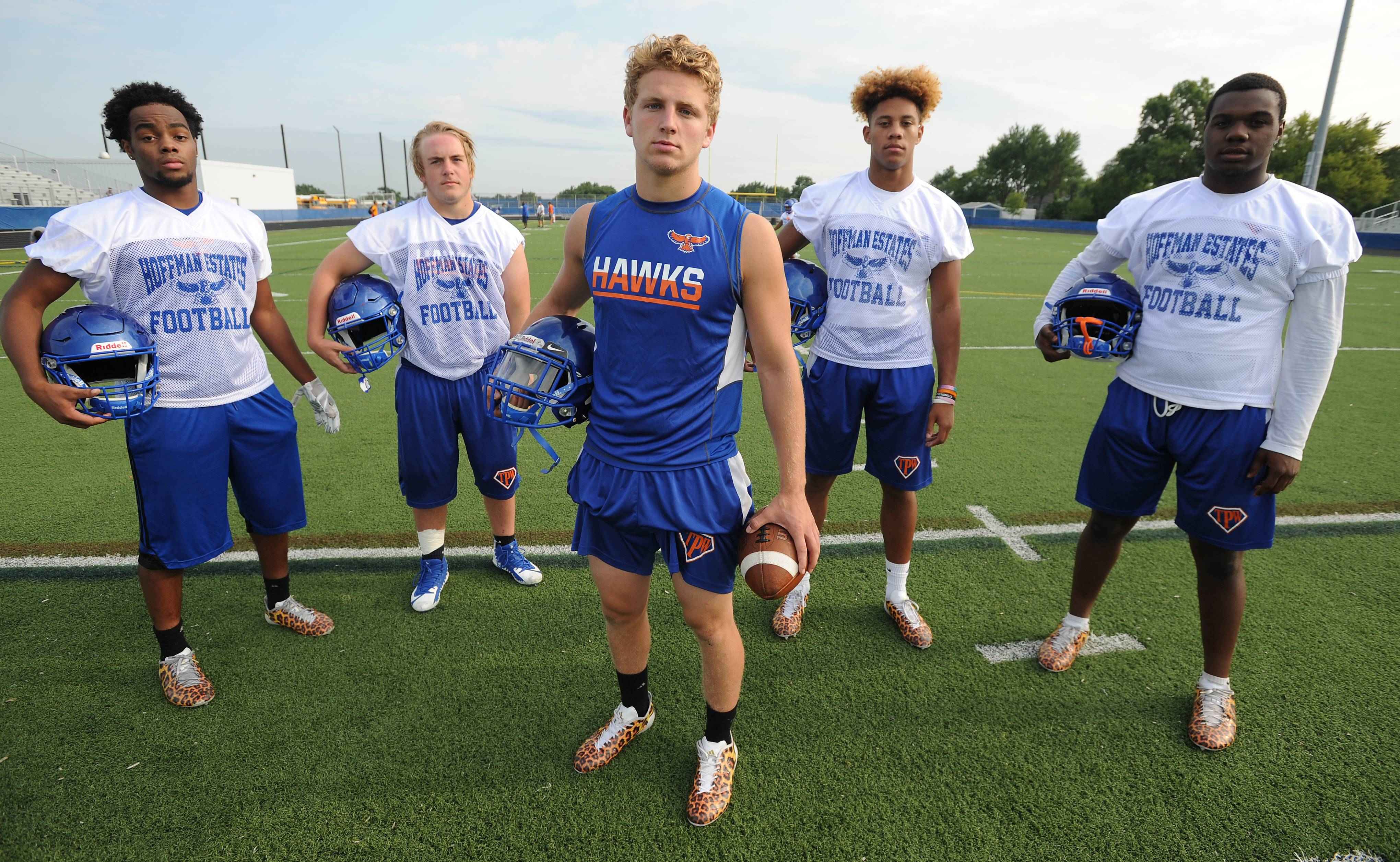 Hoffman Estates football players, safety Trevon Hall, linebacker Jimmy Burks, quarterback Austin Coalson and receiver Jayvon Blissett and linebacker/receiver Jaylan Alexander on day one of the high school football season Monday.