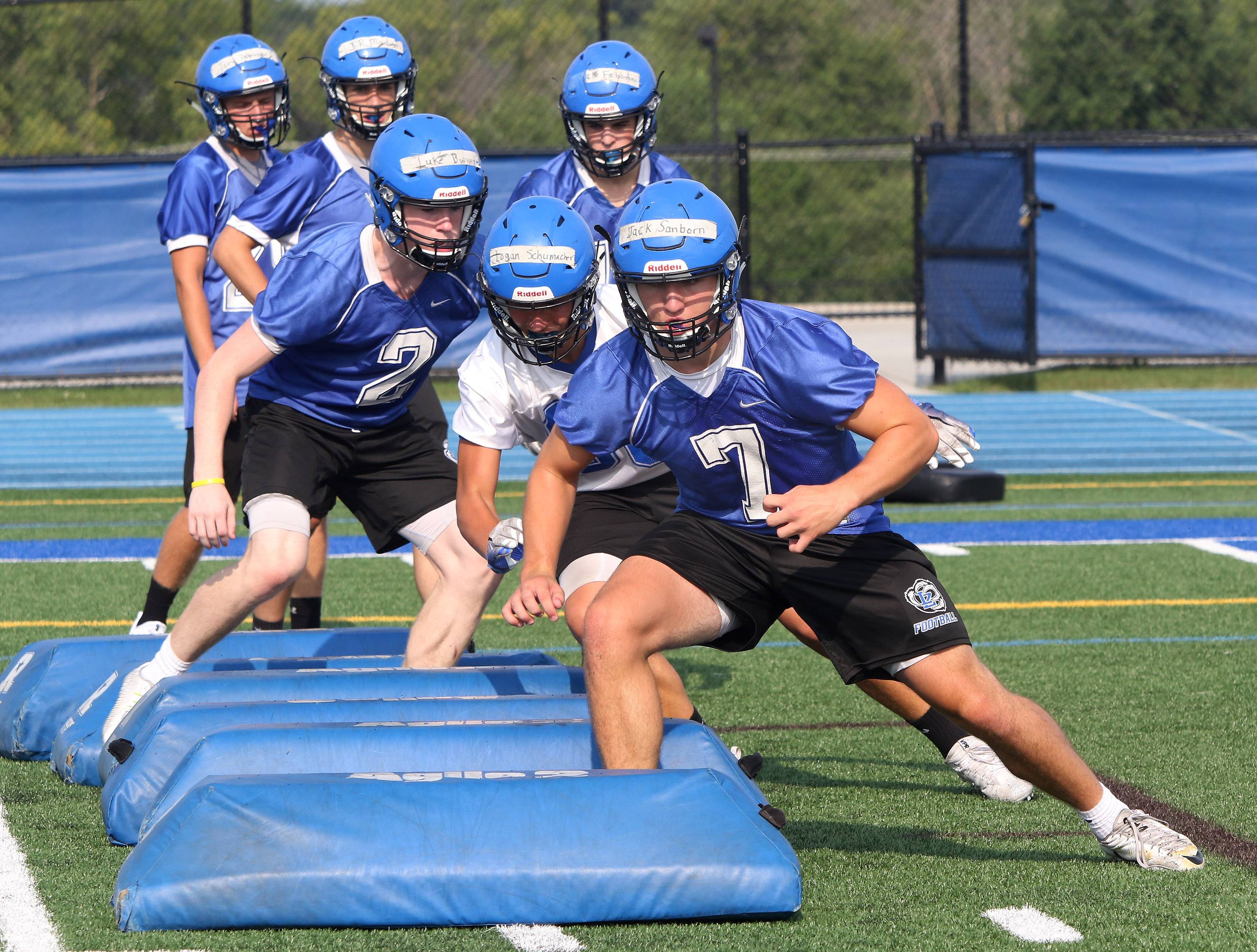 Wisconsin-bound linebacker Jack Sanborn leads a group of players in running drills during the first day of football practice at Lake Zurich on Monday.